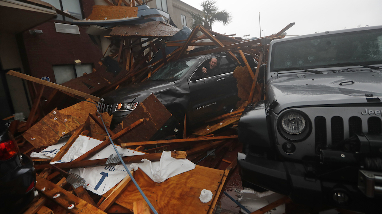 <div class='meta'><div class='origin-logo' data-origin='AP'></div><span class='caption-text' data-credit='AP Photo/Gerald Herbert'>A storm chaser climbs into his vehicle during the eye of Hurricane Michael to retrieve equipment after a hotel canopy collapsed in Panama City Beach, Fla., Oct. 10, 2018.</span></div>
