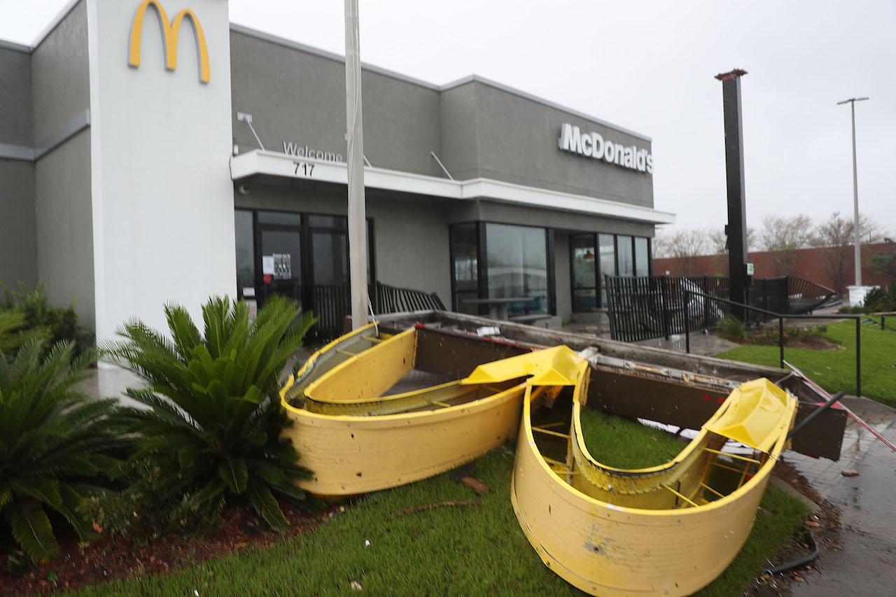 <div class='meta'><div class='origin-logo' data-origin='Creative Content'></div><span class='caption-text' data-credit='Joe Raedle/Getty Images'>A McDonald's sign is seen laying on the ground after it was knocked down by hurricane Michael as it passed through the area on October 10, 2018, in Panama City, Fla.</span></div>