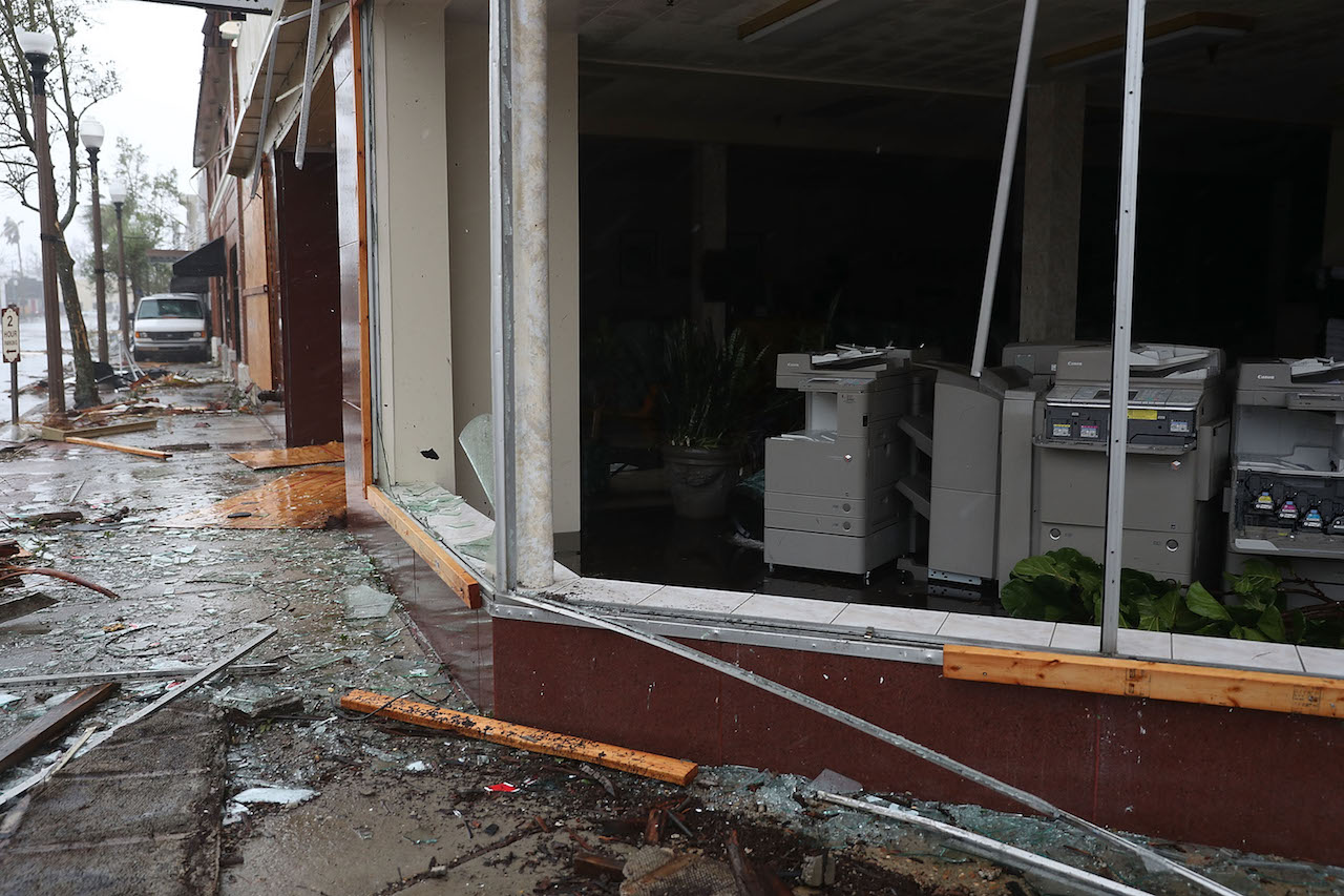 <div class='meta'><div class='origin-logo' data-origin='Creative Content'></div><span class='caption-text' data-credit='Joe Readle/Getty Images'>A store's windows are seen shattered as hurricane Michael passed through the downtown area on October 10, 2018, in Panama City, Florida.</span></div>