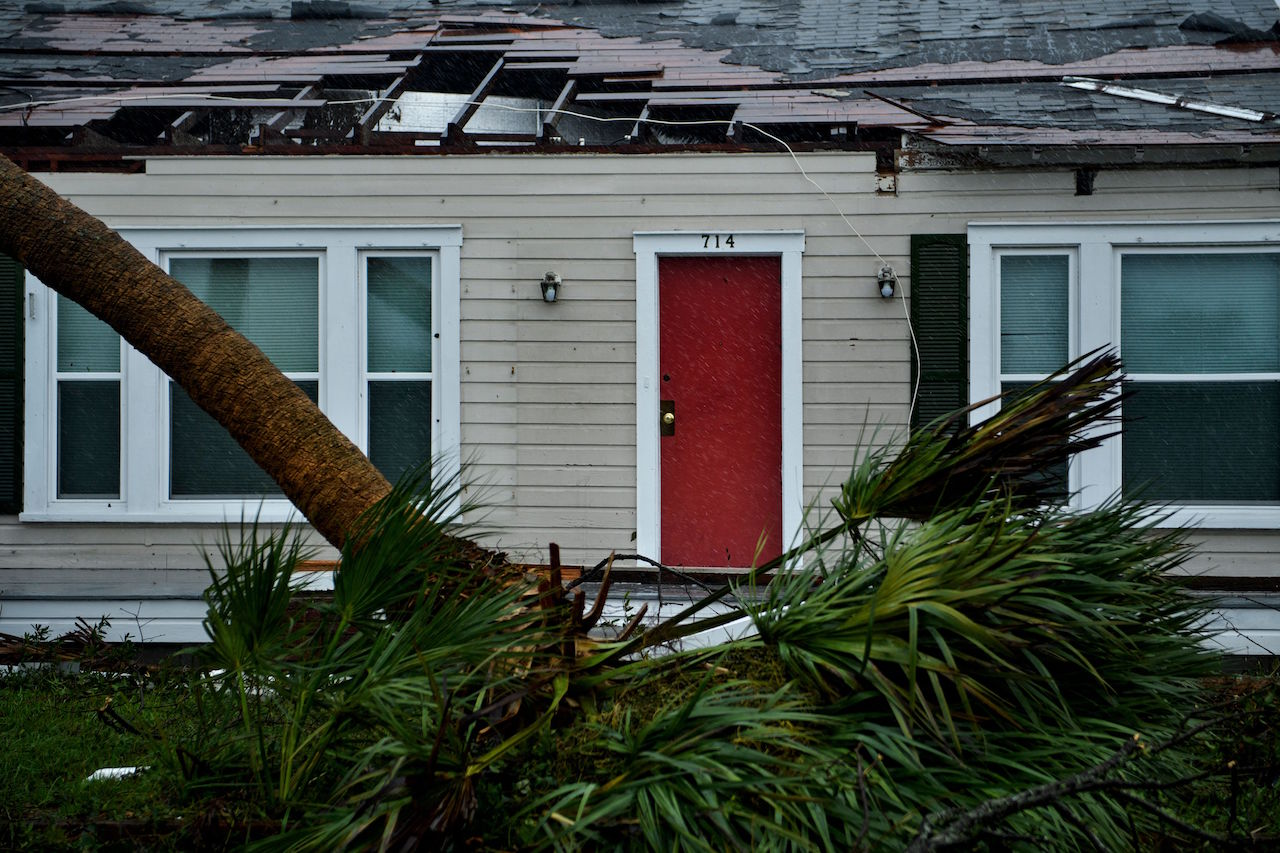 <div class='meta'><div class='origin-logo' data-origin='Creative Content'></div><span class='caption-text' data-credit='Brendan Smialowski/AFP/Getty Images'>A house is seen with damage to its roof and downed trees during Hurricane Michael October 10, 2018, in Panama City, Florida.</span></div>