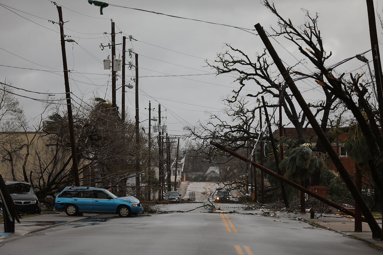 <div class='meta'><div class='origin-logo' data-origin='Creative Content'></div><span class='caption-text' data-credit='Joe Readle/Getty Images'>Downed power lines are seen after hurricane Michael passed through the downtown area on October 10, 2018, in Panama City, Florida.</span></div>