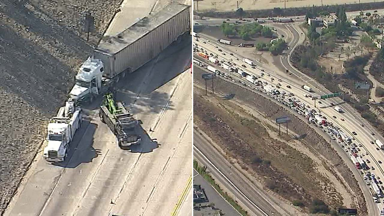 A crash involving a big rig shut down eastbound lanes of the 210 Freeway in Irwindale on Wednesday, Oct. 10, 2018.