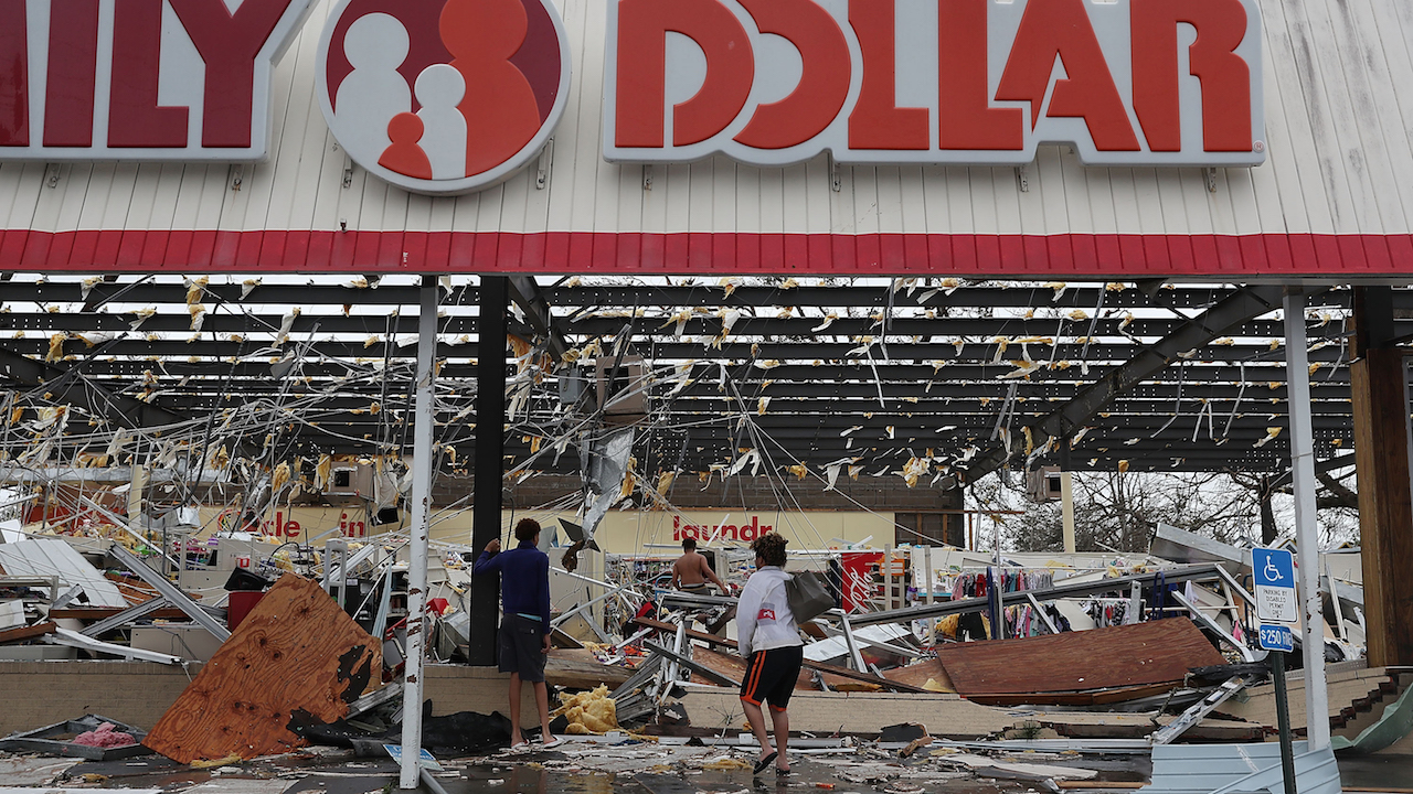 <div class='meta'><div class='origin-logo' data-origin='Creative Content'></div><span class='caption-text' data-credit='Mark Wallheiser/Getty Images'>People look on at a damaged store after Hurricane Michael passed through on October 10, 2018, in Panama City, Florida.</span></div>