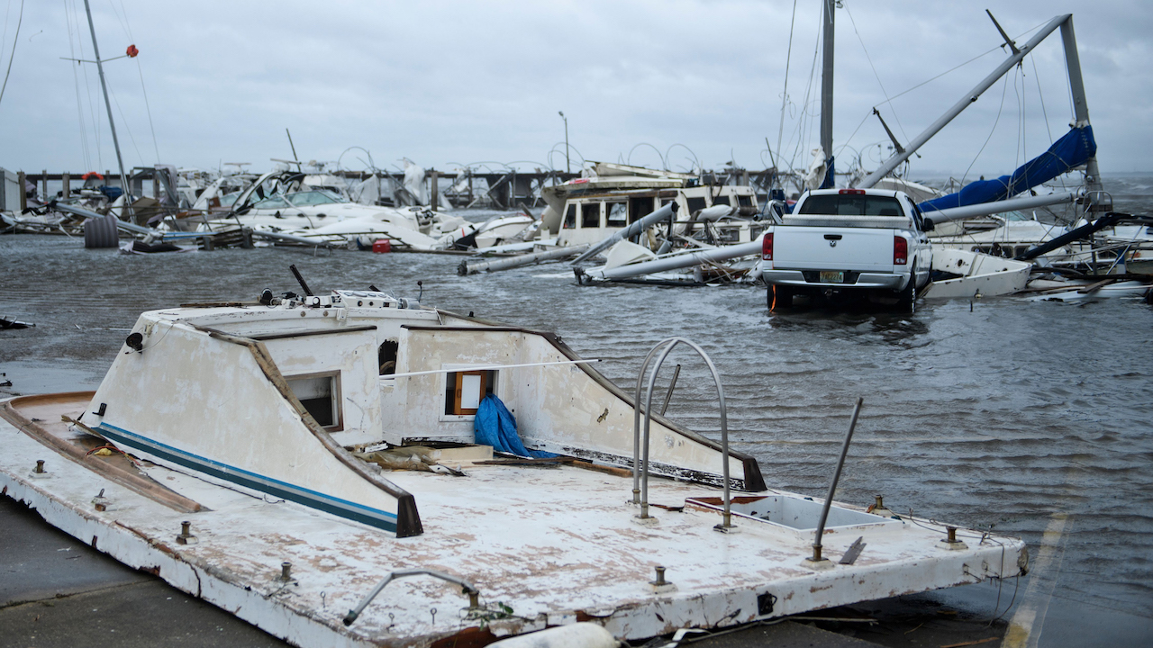<div class='meta'><div class='origin-logo' data-origin='Creative Content'></div><span class='caption-text' data-credit='Brendan Smialowski/AFP/Getty Images'>Damaged boats and a truck are seen in a marina after Hurricane Michael October 10, 2018, in Panama City, Florida.</span></div>