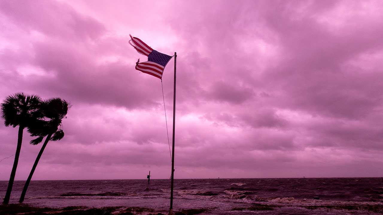 <div class='meta'><div class='origin-logo' data-origin='none'></div><span class='caption-text' data-credit='Mark Wallheiser/Getty Images'>An American flag battered by Hurricane Michael continues to fly in the in the rose colored light of sunset at Shell Point Beach on October 10, 2018 in Crawfordville, Florida.</span></div>