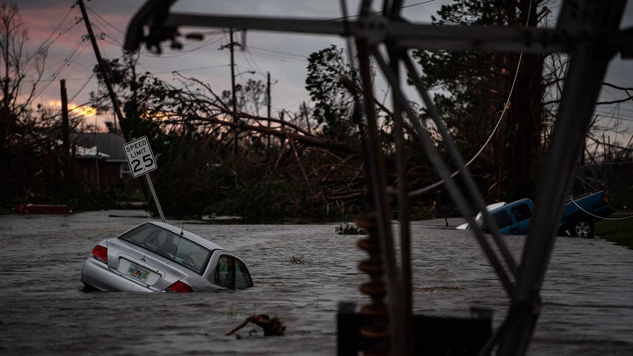 <div class='meta'><div class='origin-logo' data-origin='none'></div><span class='caption-text' data-credit='Jabin Botsford/The Washington Post via Getty Images'>A car is seen caught in flood water after category 4 Hurricane Michael made land fall along the Florida panhandle, on Wednesday, Oct. 10, 2018 in Panama City, FL.</span></div>