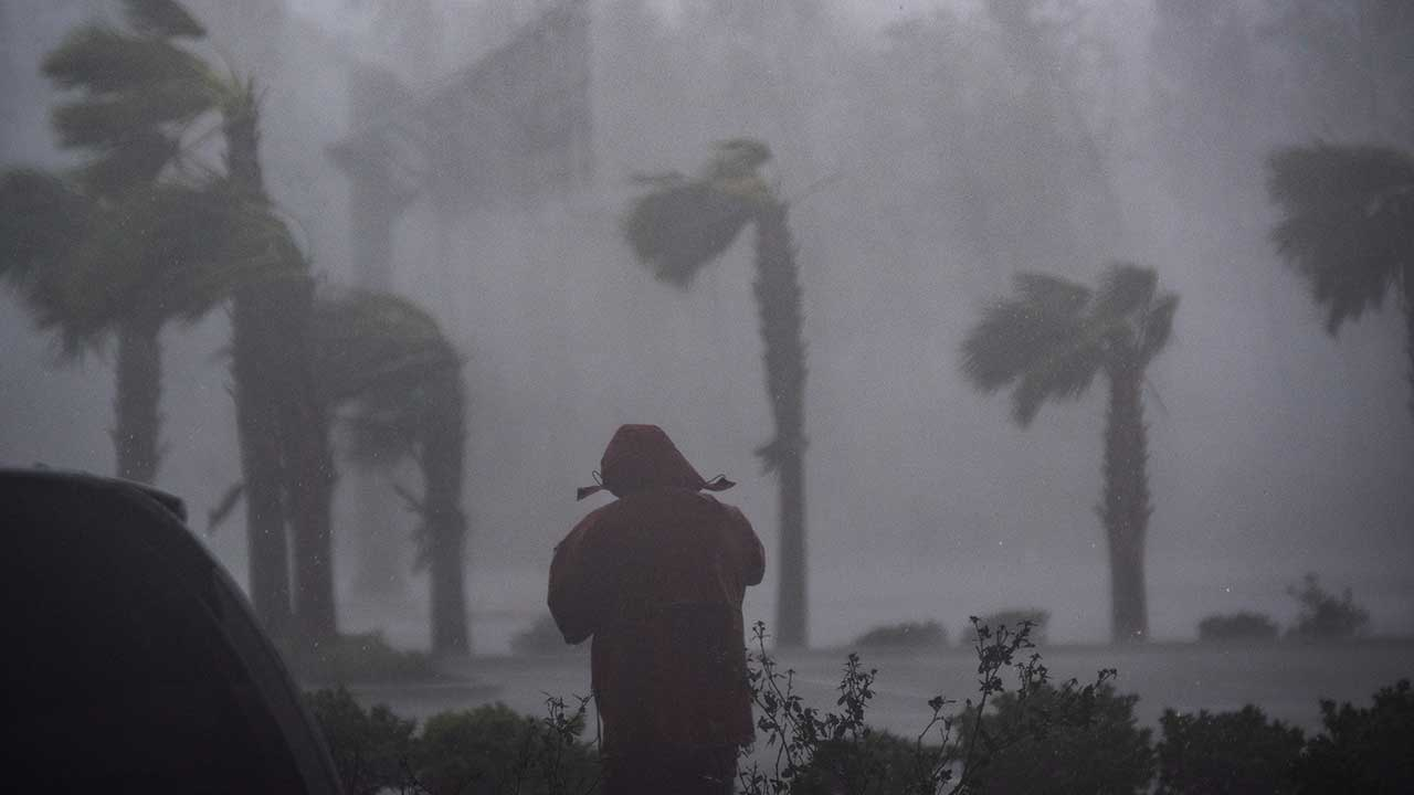 <div class='meta'><div class='origin-logo' data-origin='none'></div><span class='caption-text' data-credit='Jabin Botsford/The Washington Post via Getty Images'>Television reporters stand watching as category 4 Hurricane Michael makes land fall along the Florida panhandle, on Wednesday, Oct. 10, 2018 in Panama City Beach, FL.</span></div>