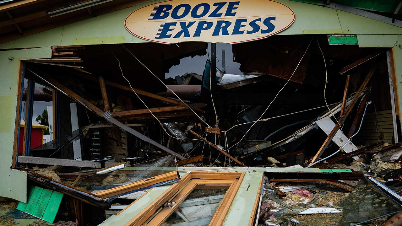 <div class='meta'><div class='origin-logo' data-origin='none'></div><span class='caption-text' data-credit='Jabin Botsford/The Washington Post via Getty Images'>A Booze Express is seen damaged after category 4 Hurricane Michael made land fall along the Florida panhandle, on Wednesday, Oct. 10, 2018 in Panama City Beach, FL.</span></div>