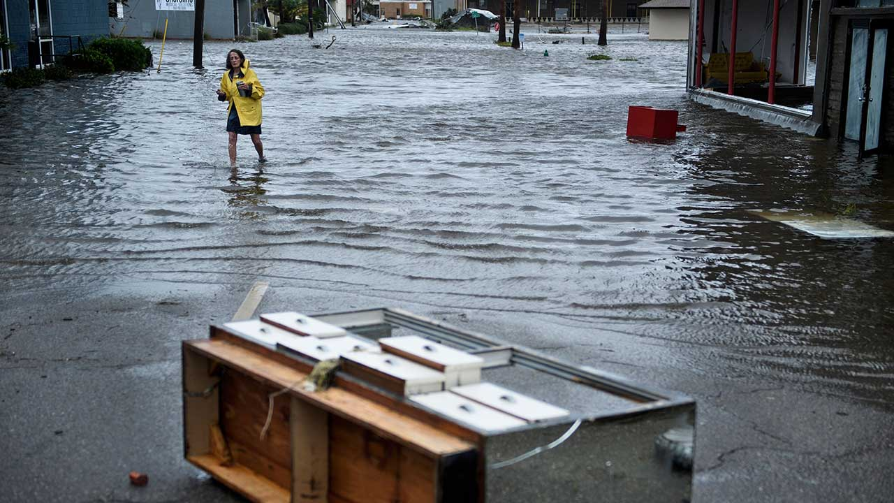 <div class='meta'><div class='origin-logo' data-origin='none'></div><span class='caption-text' data-credit='BRENDAN SMIALOWSKI/AFP/Getty Images'>A woman crosses a flooded street after Hurricane Michael made landfall on October 10, 2018 in Panama City, Florida.</span></div>