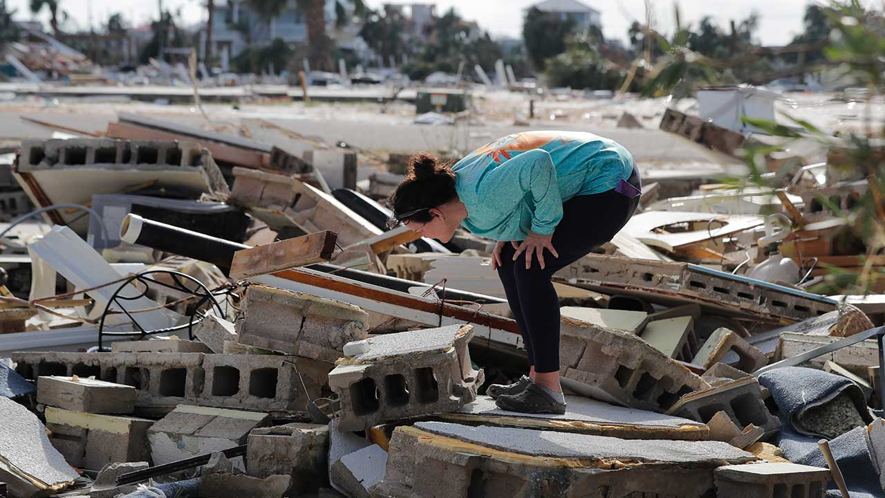 <div class='meta'><div class='origin-logo' data-origin='none'></div><span class='caption-text' data-credit='Gerald Herbert/AP Photo'>Mishelle McPherson looks for her friend in the rubble of her home, since she knows she stayed behind in the home during Hurricane Michael, in Mexico Beach, Fla., Thursday, Oct. 11,</span></div>