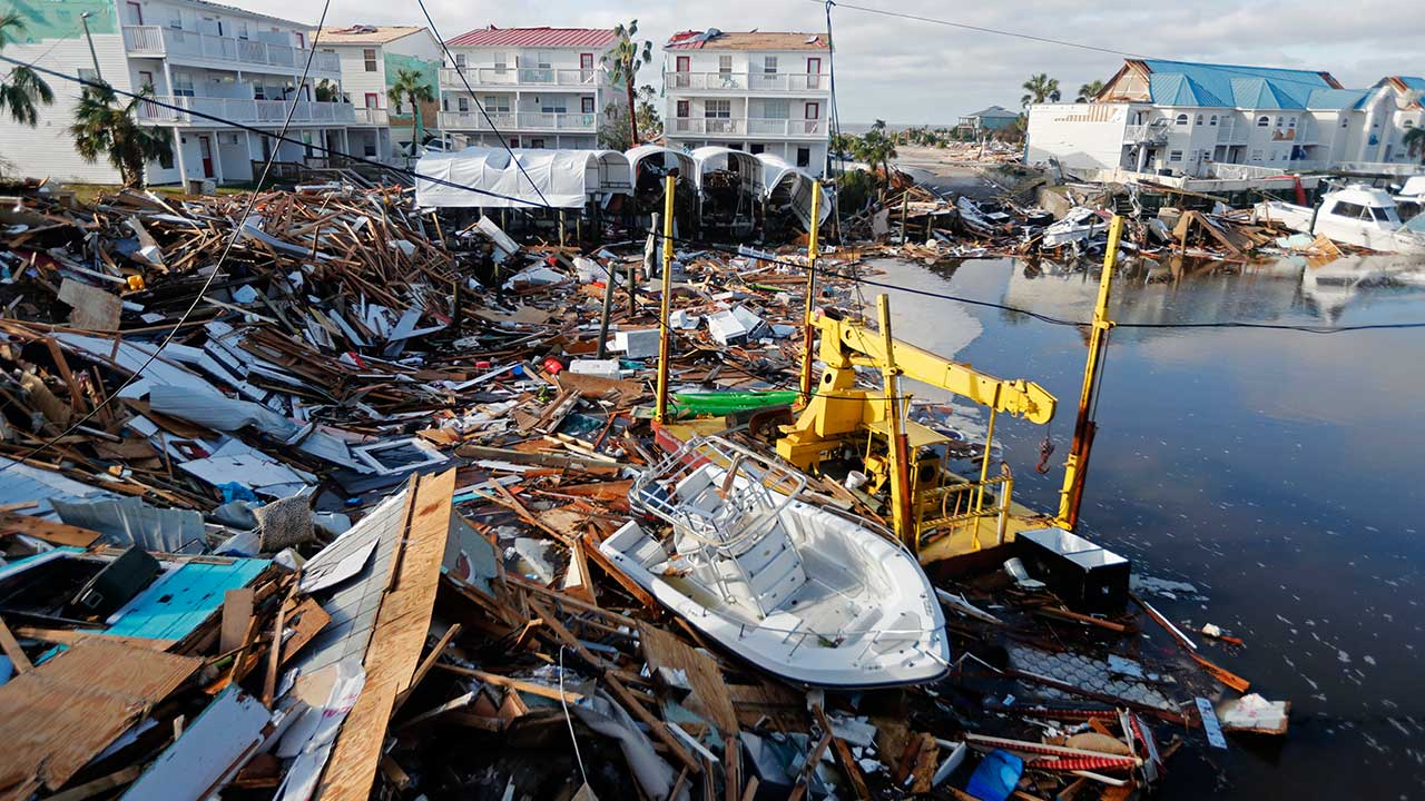 <div class='meta'><div class='origin-logo' data-origin='none'></div><span class='caption-text' data-credit='Gerald Herbert/AP Photo'>A boat sits amidst debris in the aftermath of Hurricane Michael in Mexico Beach, Fla., Thursday, Oct. 11, 2018.</span></div>