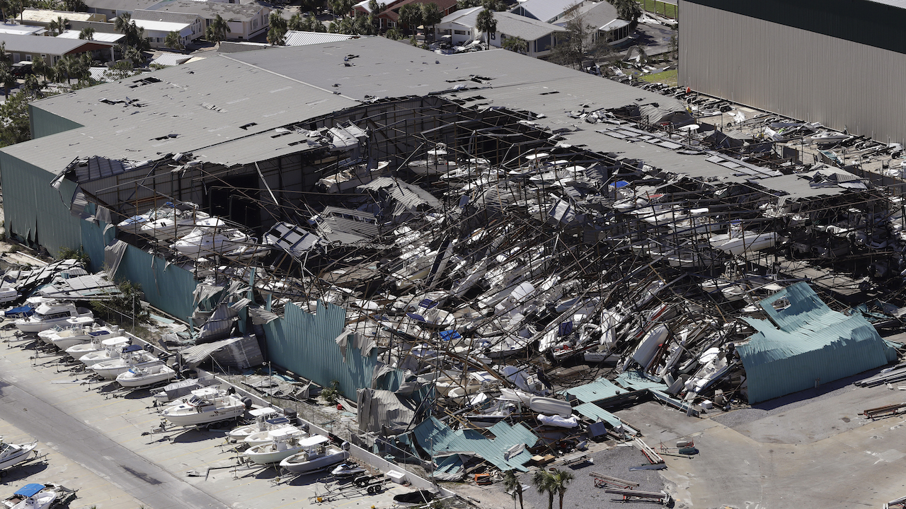 <div class='meta'><div class='origin-logo' data-origin='AP'></div><span class='caption-text' data-credit='AP Photo/Chris O'Meara'>A roof over a boat storage building is collapsed following Hurricane Michael Thursday, Oct. 11, 2018, in Panama City Beach, Fla.</span></div>