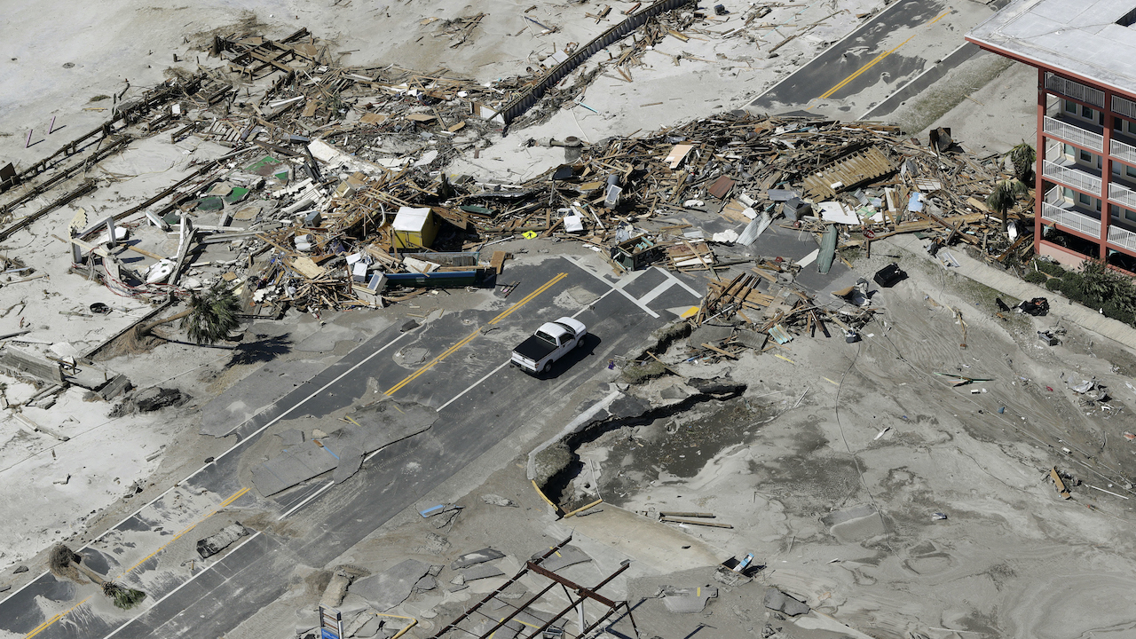"<div class=""meta image-caption""><div class=""origin-logo origin-image ap""><span>AP</span></div><span class=""caption-text"">Debris from homes destroyed by Hurricane Michael block a road Thursday, Oct. 11, 2018, in Mexico Beach, Fla. (AP Photo/Chris O'Meara)</span></div>"