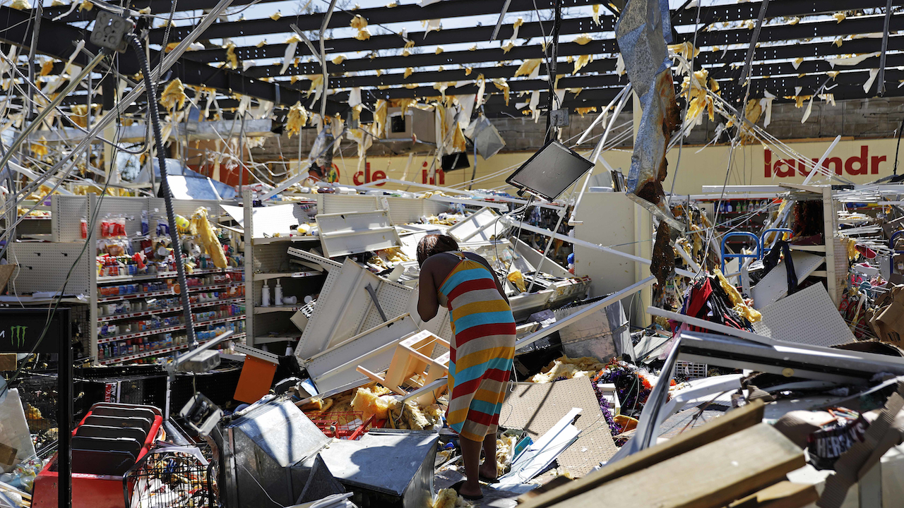 <div class='meta'><div class='origin-logo' data-origin='AP'></div><span class='caption-text' data-credit='AP Photo/David Goldman'>A woman walks through a damaged store in the aftermath of Hurricane Michael in Springfield, Fla., Thursday, Oct. 11, 2018.</span></div>