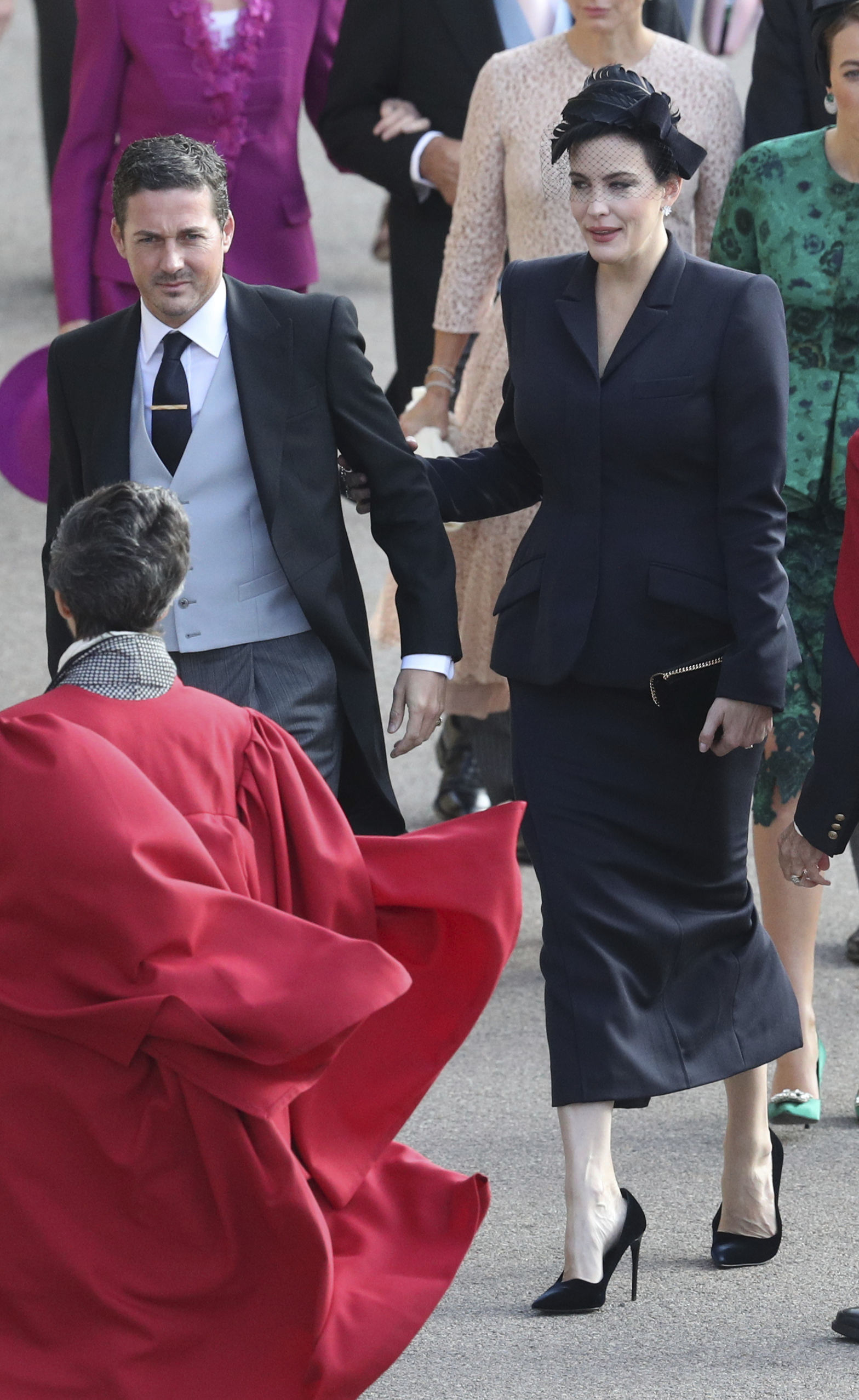 <div class='meta'><div class='origin-logo' data-origin='none'></div><span class='caption-text' data-credit='Andrew Matthews/Pool via AP'>Liv Tyler arrives for the wedding of Princess Eugenie of York and Jack Brooksbank at St George's Chapel, Windsor Castle, near London, England, Friday Oct. 12, 2018.</span></div>