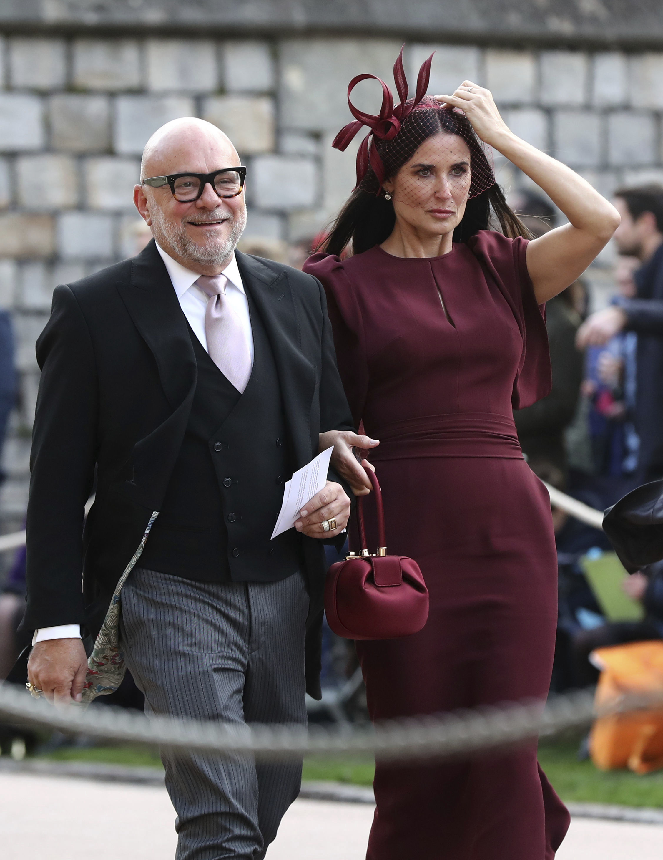 <div class='meta'><div class='origin-logo' data-origin='none'></div><span class='caption-text' data-credit='Gareth Fuller/Pool via AP'>Demi Moore arrives ahead of the wedding of Princess Eugenie of York and Jack Brooksbank at St George's Chapel, Windsor Castle, near London, England, Friday Oct. 12, 2018.</span></div>