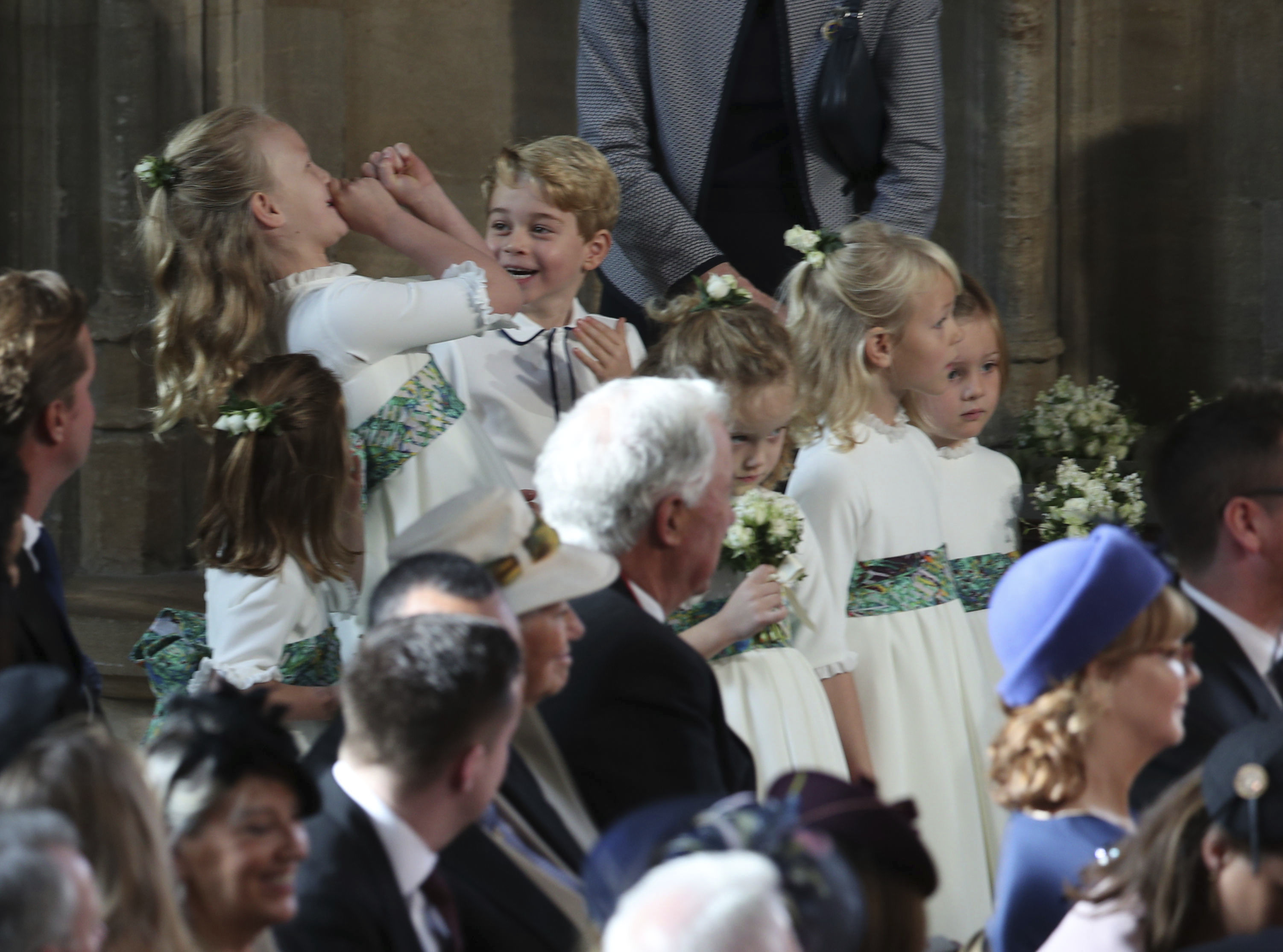 <div class='meta'><div class='origin-logo' data-origin='none'></div><span class='caption-text' data-credit='Yui Mok, Pool via AP'>The bridesmaids and page boys, including Prince George and Princess Charlotte, arrive for the wedding of Princess Eugenie of York and Jack Brooksbank in St George'€™s Chapel.</span></div>