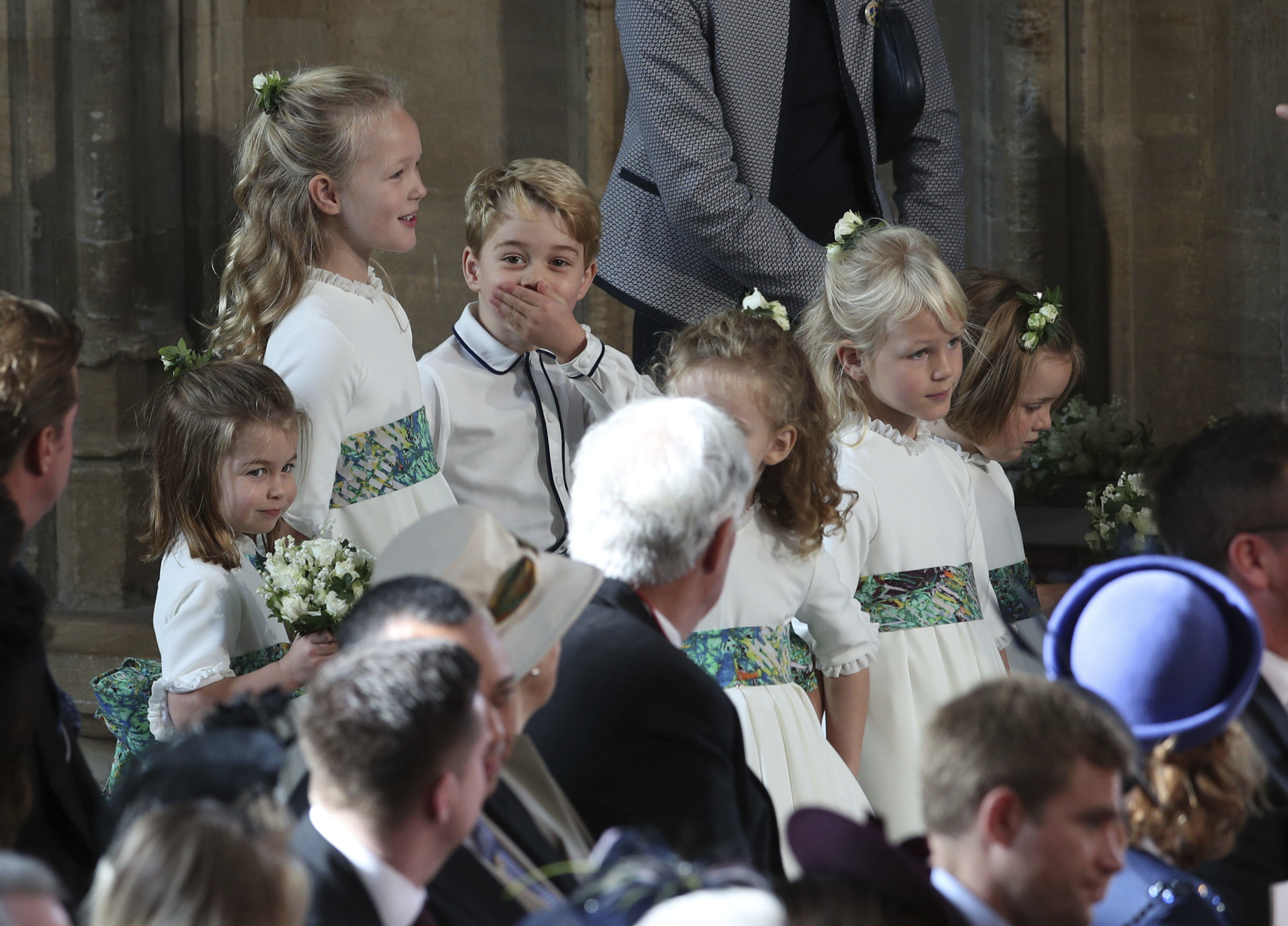 <div class='meta'><div class='origin-logo' data-origin='none'></div><span class='caption-text' data-credit='Yui Mok, Pool via AP'>The bridesmaids and page boys, including Prince George and Princess Charlotte, arrive for the wedding of Princess Eugenie of York and Jack Brooksbank in St George's Chapel.</span></div>