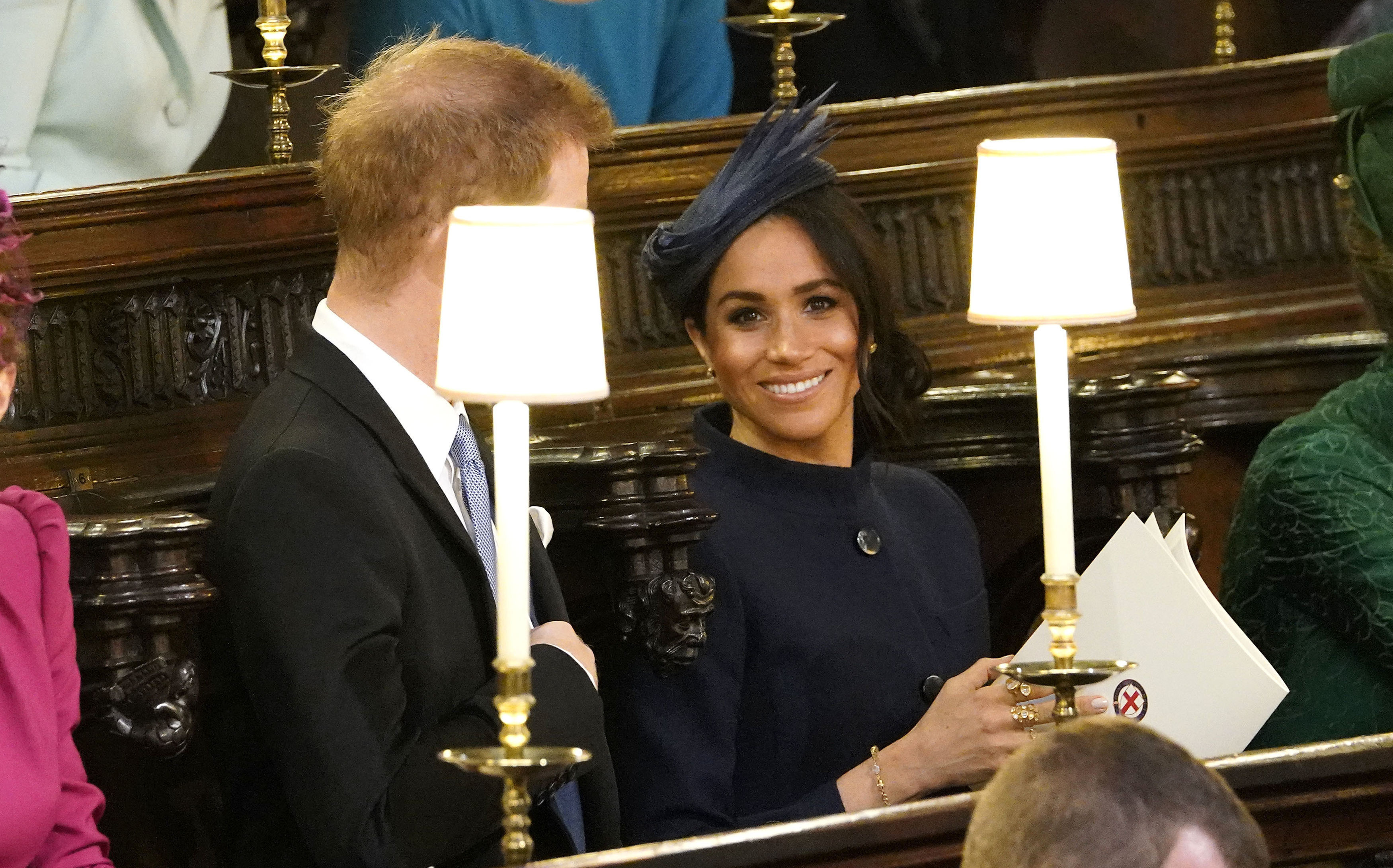 <div class='meta'><div class='origin-logo' data-origin='none'></div><span class='caption-text' data-credit='Danny Lawson/Pool via AP'>Prince Harry and Meghan, Duchess of Sussex take their seats ahead of the wedding of Princess Eugenie of York and Jack Brooksbank in St George's Chapel, Windsor Castle.</span></div>