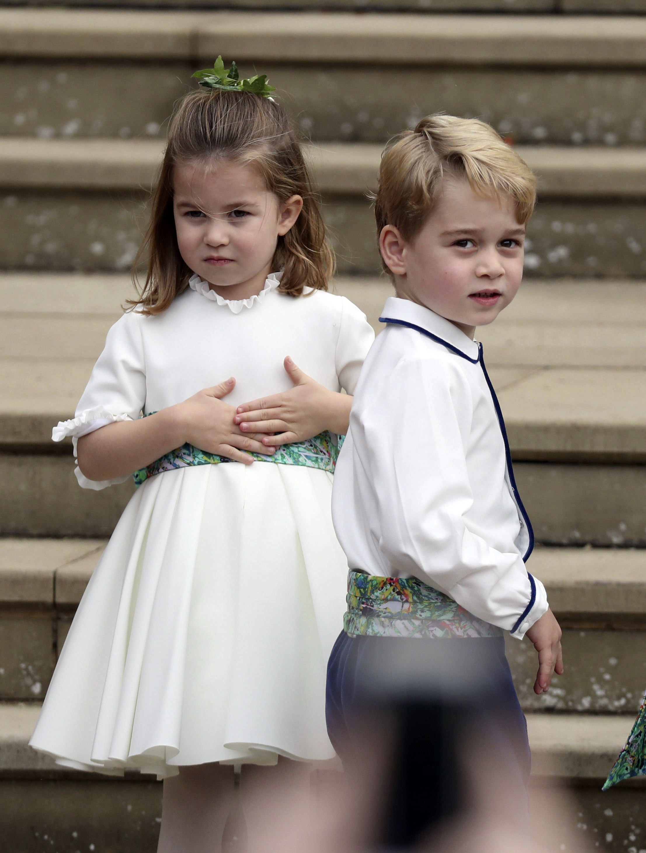 <div class='meta'><div class='origin-logo' data-origin='none'></div><span class='caption-text' data-credit='Steve Parsons/Pool via AP'>Prince George and Princess Charlotte arrive for the the wedding of Princess Eugenie of York and Jack Brooksbank at St George€™'s Chapel, Windsor Castle, near London, England.</span></div>