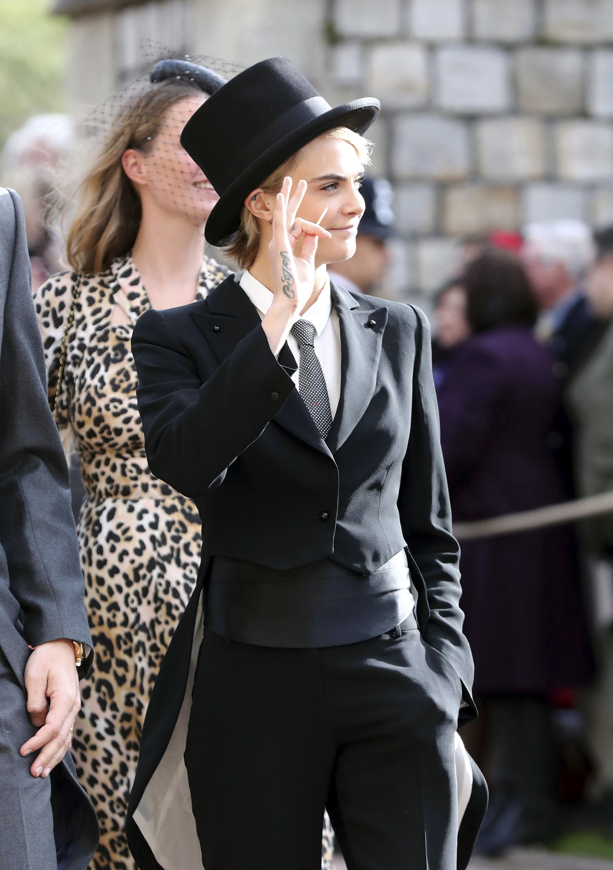 <div class='meta'><div class='origin-logo' data-origin='none'></div><span class='caption-text' data-credit='Gareth Fuller/Pool via AP'>Cara Delevingne arrives ahead of the wedding of Princess Eugenie of York and Jack Brooksbank at St George's Chapel, Windsor Castle, near London, England, Friday Oct. 12, 2018.</span></div>