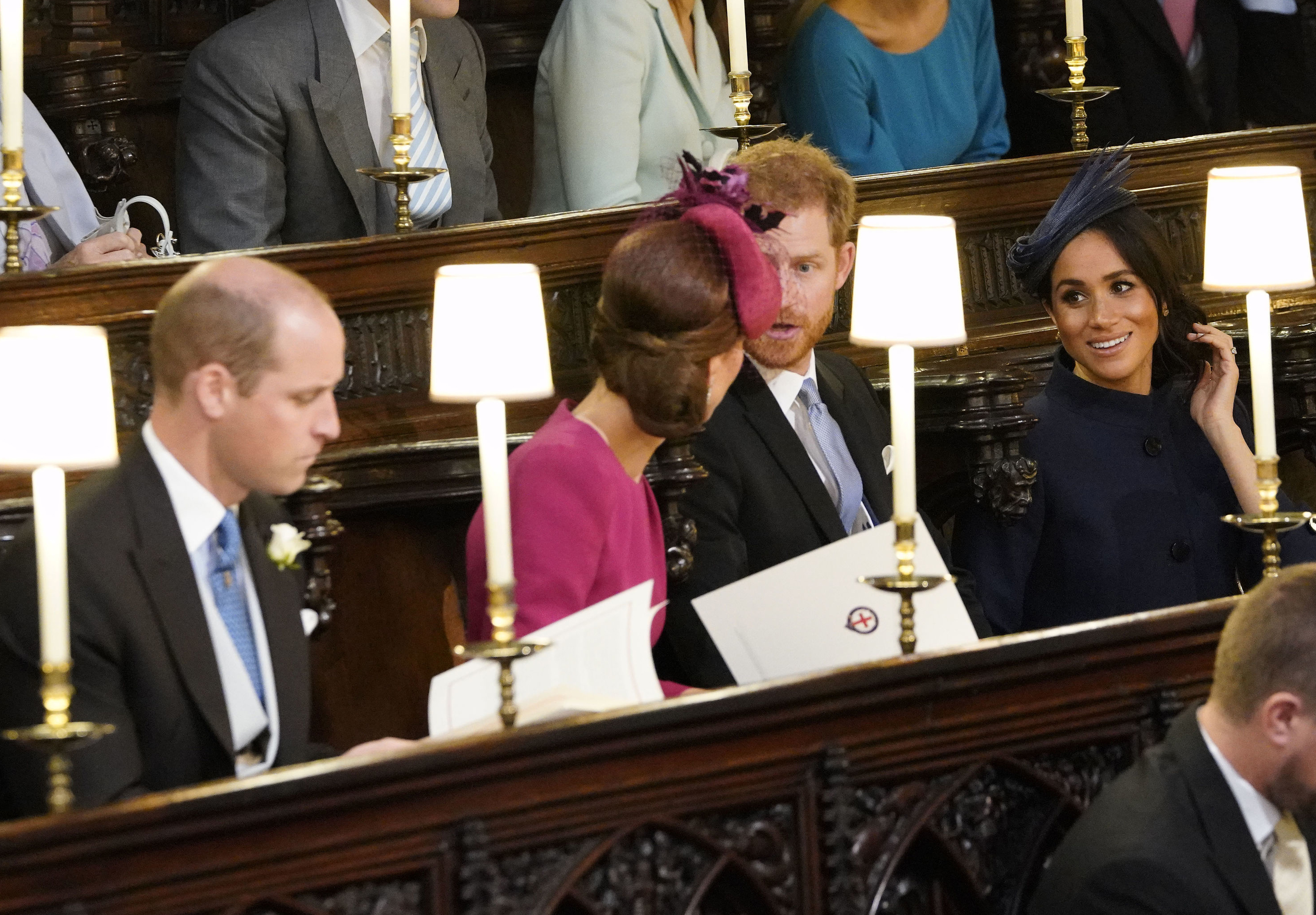 <div class='meta'><div class='origin-logo' data-origin='none'></div><span class='caption-text' data-credit='Danny Lawson/Pool via AP'>Prince William, Kate Duchess of Cambridge, Prince Harry and Meghan Duchess of Sussex take their seats ahead of the wedding of Princess Eugenie of York and Jack Brooksbank.</span></div>