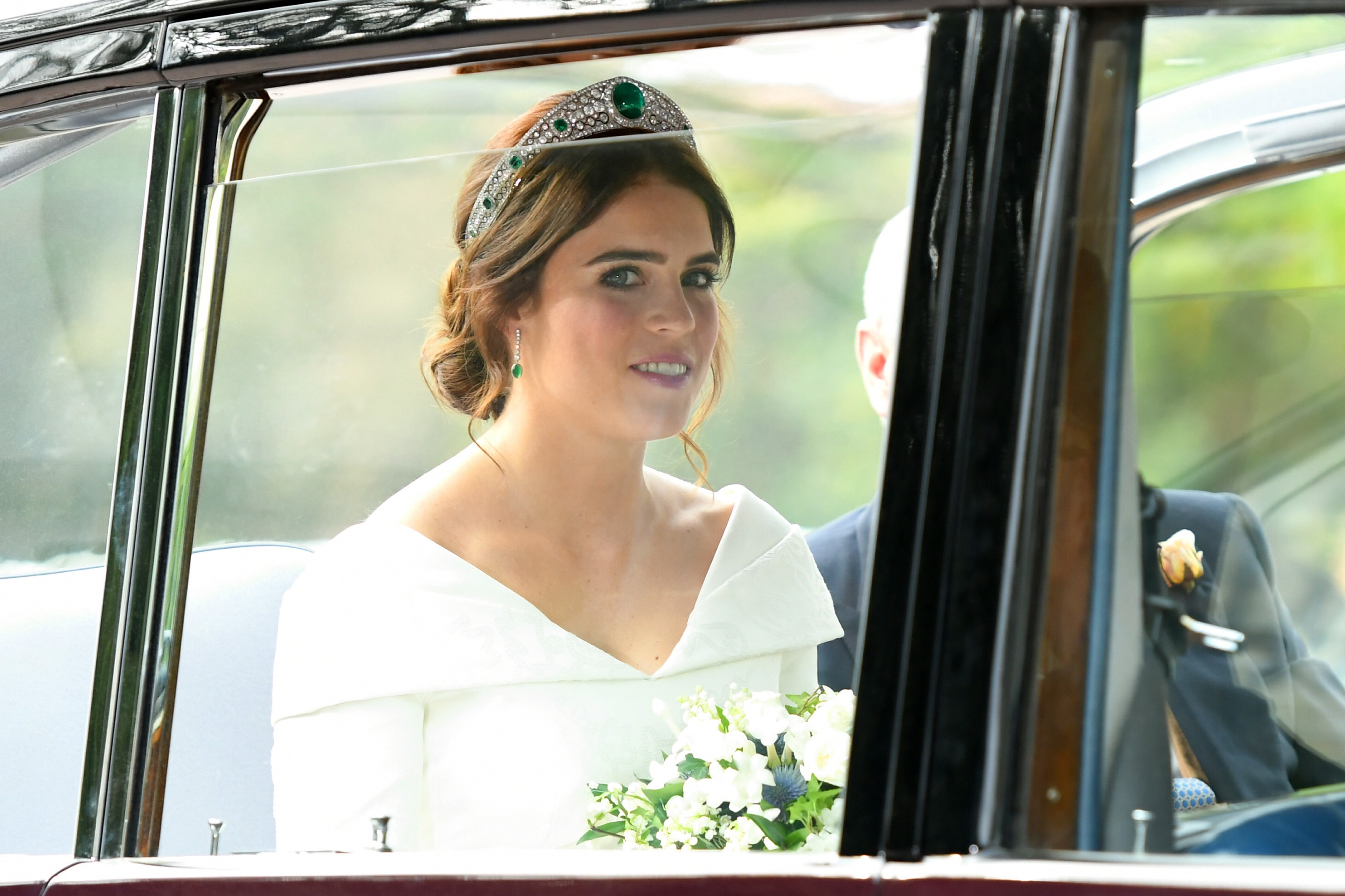 <div class='meta'><div class='origin-logo' data-origin='none'></div><span class='caption-text' data-credit='Karwai Tang/WireImage via Getty'>Bride Princess Eugenie of York with her father Prince Andrew, Duke of York arrives by car for her Royal wedding to Mr. Jack Brooksbank at St. George's Chapel on October 12, 2018.</span></div>