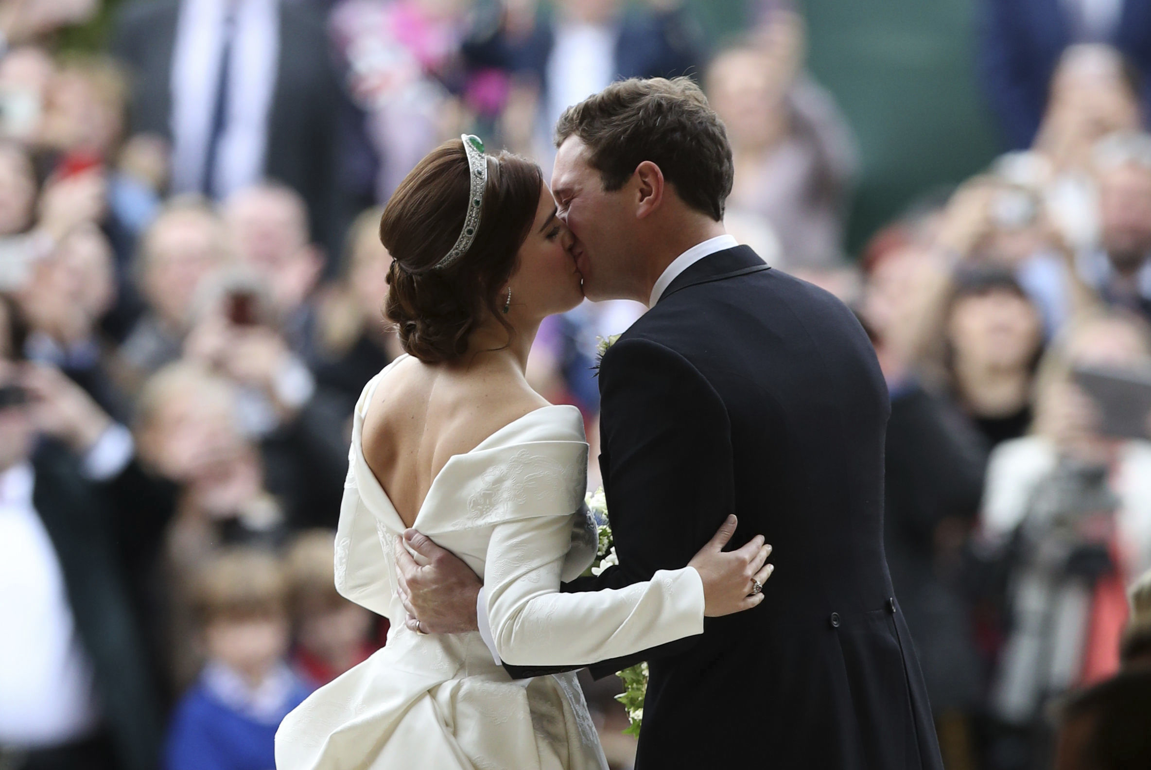 <div class='meta'><div class='origin-logo' data-origin='none'></div><span class='caption-text' data-credit='Yui Mok, Pool via AP'>Princess Eugenie of York and Jack Brooksbank kiss after their wedding in St George's Chapel, Windsor Castle, near London, England, Friday Oct. 12, 2018.</span></div>
