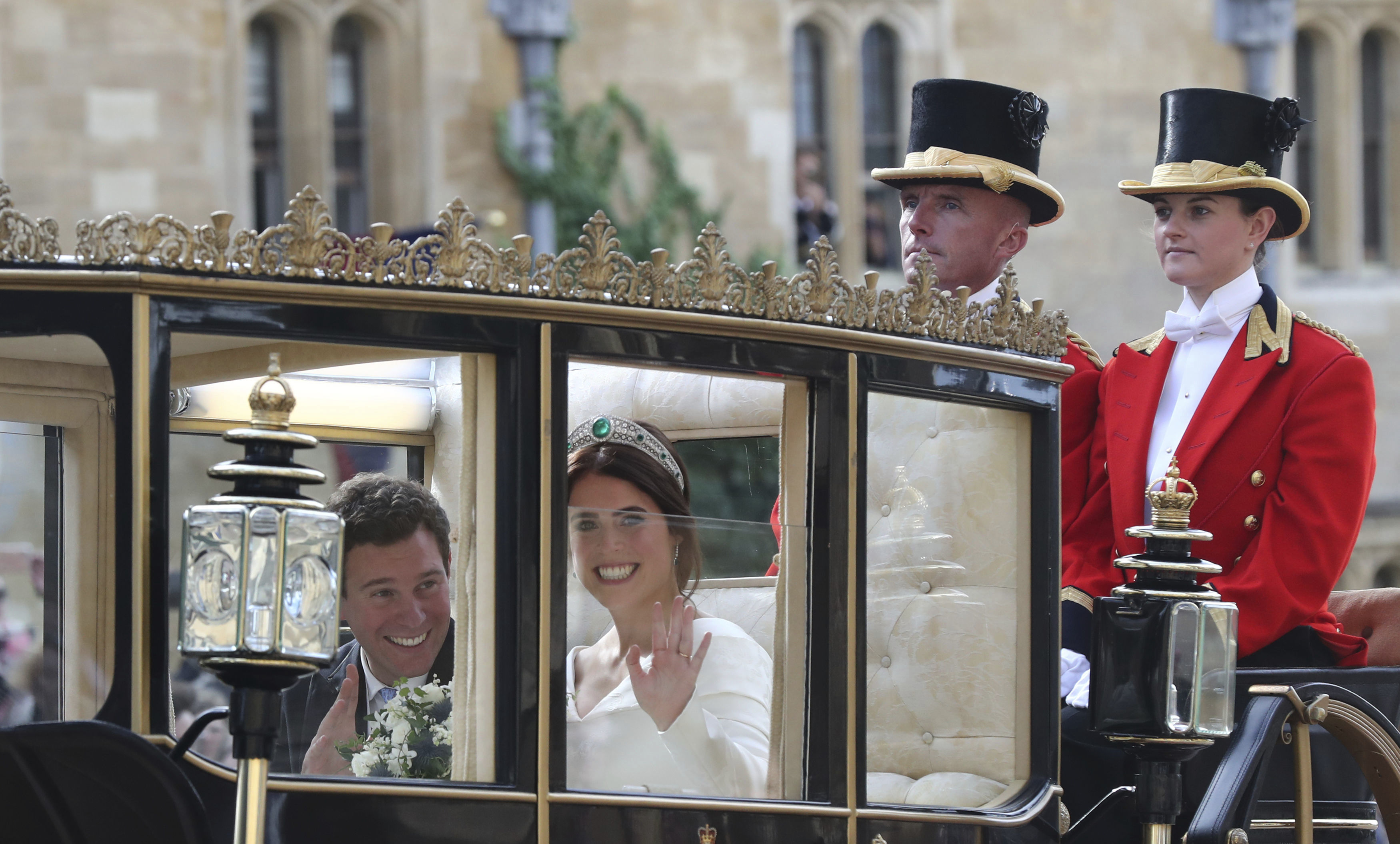 <div class='meta'><div class='origin-logo' data-origin='none'></div><span class='caption-text' data-credit='Gareth Fuller/Pool via AP'>Britain's Princess Eugenie of York, right, and her husband Jack Brooksbank travel in the Scottish State Coach following their wedding at St George's Chapel, Windsor Castle.</span></div>