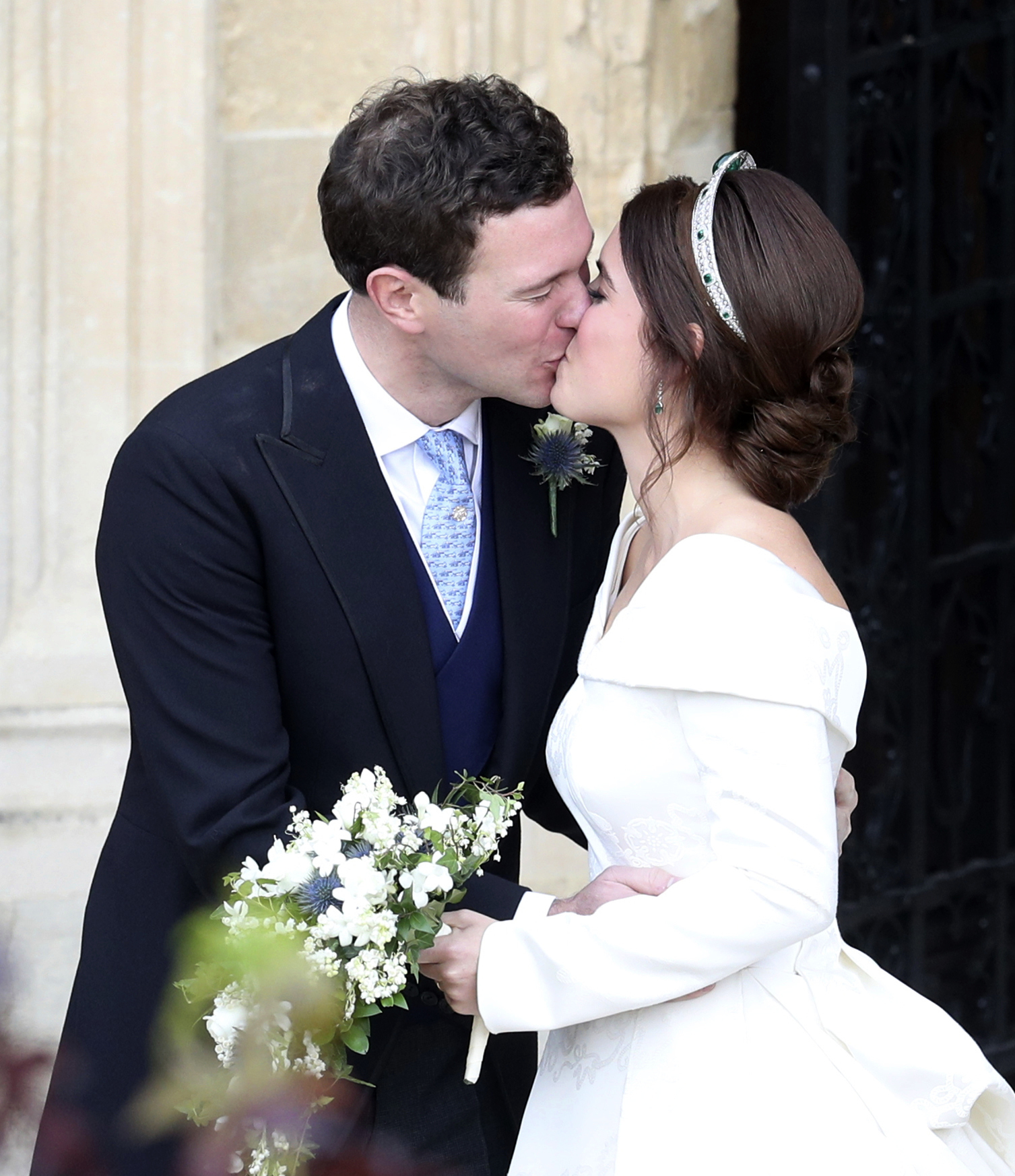 <div class='meta'><div class='origin-logo' data-origin='none'></div><span class='caption-text' data-credit='Andrew Matthews, Pool via AP'>Princess Eugenie and her new husband Jack Brooksbank kiss after their wedding ceremony as they leave St George's Chapel, Windsor Castle, near London, England, Friday Oct. 12, 2018.</span></div>
