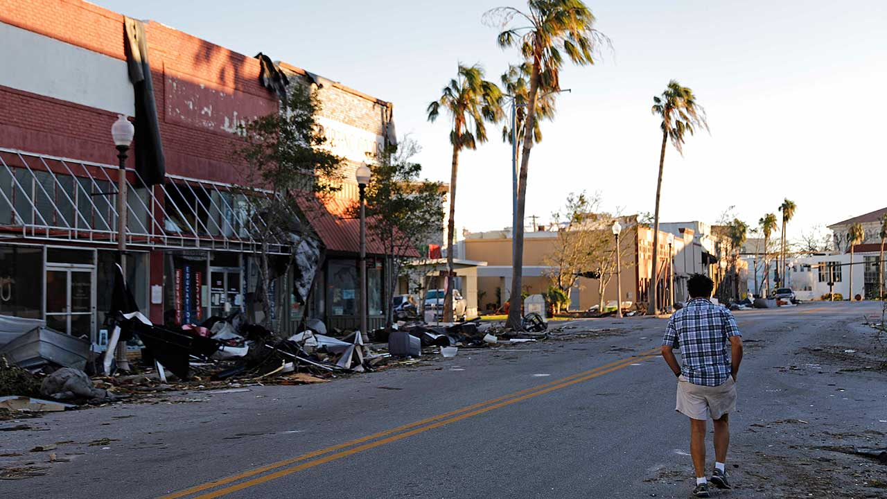 <div class='meta'><div class='origin-logo' data-origin='none'></div><span class='caption-text' data-credit='David Goldman/AP Photo'>A man walks through the damaged historical downtown district in the aftermath of Hurricane Michael in Panama City, Fla., Friday, Oct. 12, 2018.</span></div>