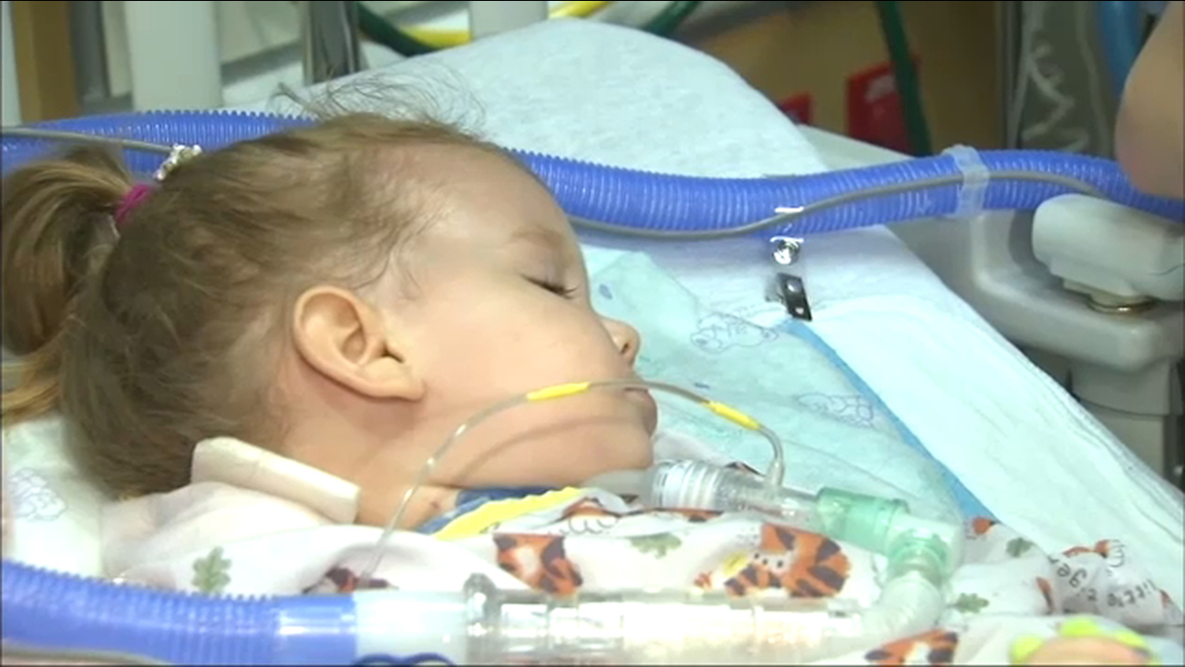 Julia Payne, 2, of Batavia, Ill., was clinically diagnosed with acute flaccid myelitis (AFM), a rare polio-like illness, in September 2018.
