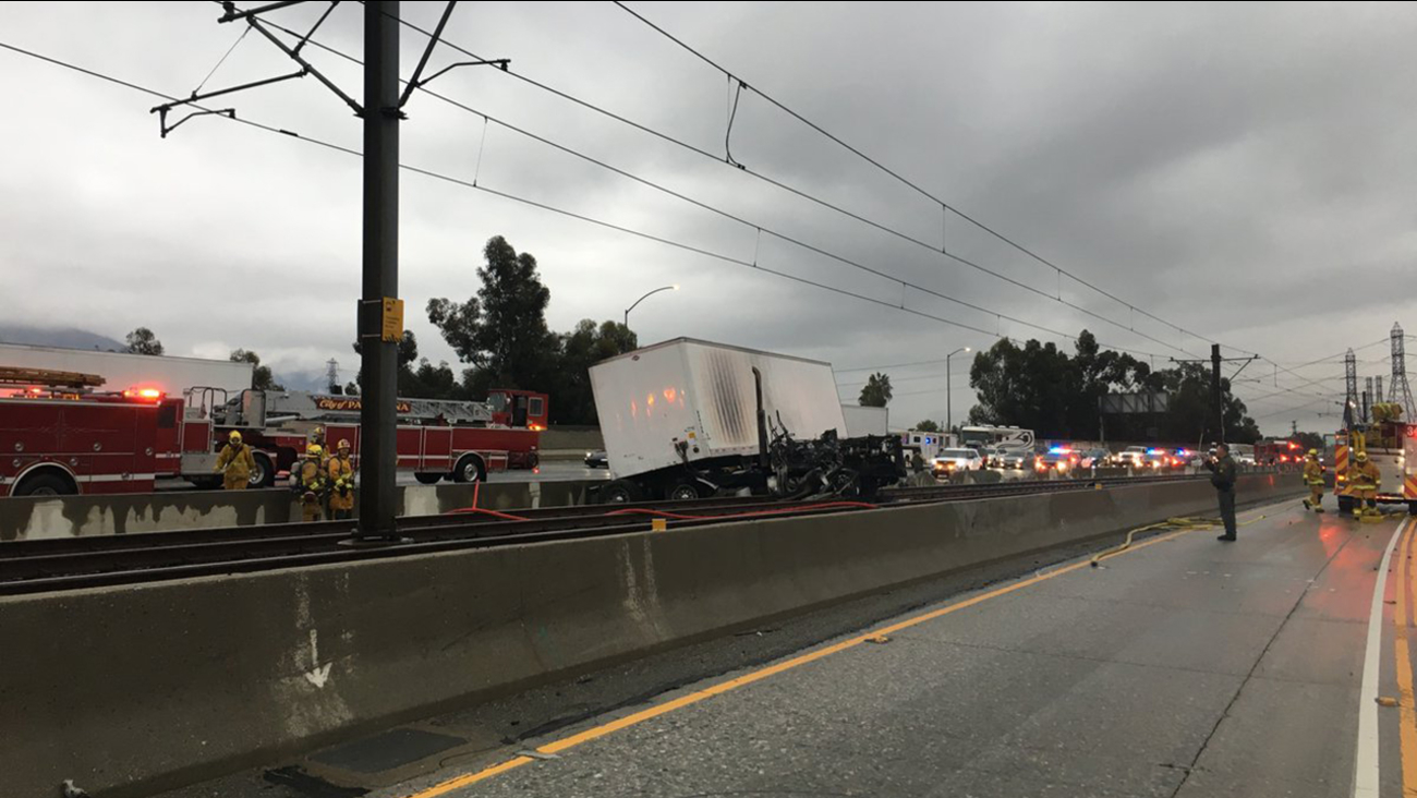 A semi-truck erupted in flames after crashing onto the light-rail tracks on the 210 Freeway in Pasadena on Saturday, Oct. 13, 2018.