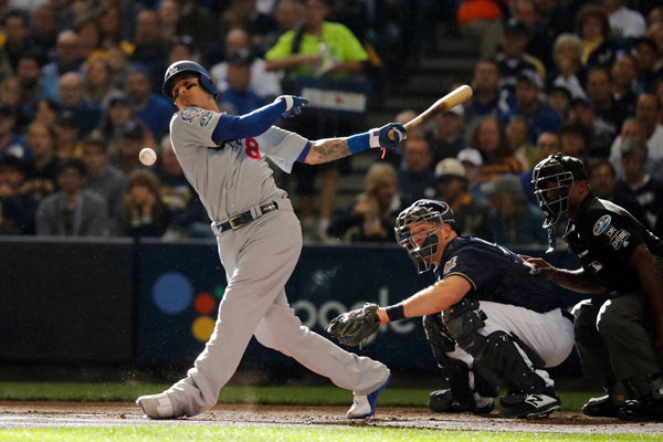 <div class='meta'><div class='origin-logo' data-origin='AP'></div><span class='caption-text' data-credit='AP Photo/Jeff Roberson'>Los Angeles Dodgers' Manny Machado fouls off a pitch by Milwaukee Brewers' Wade Miley during Game 2 of the National League Championship Series baseball game in Milwaukee.</span></div>