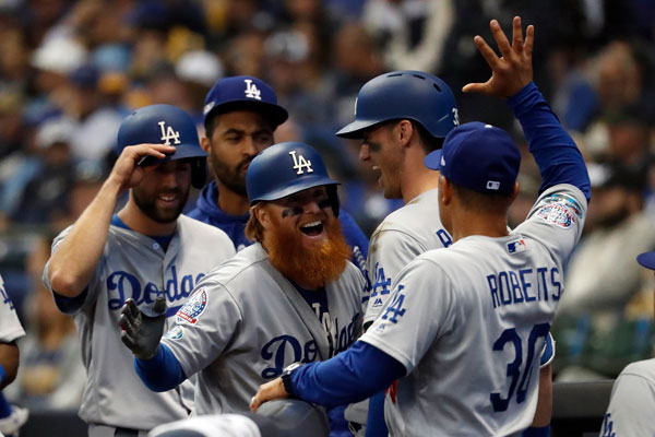 <div class='meta'><div class='origin-logo' data-origin='AP'></div><span class='caption-text' data-credit='AP Photo/Jeff Roberson'>Los Angeles Dodgers' Justin Turner celebrates with manager Dave Roberts after hitting a two-run home run during Game 2 of the National League Championship Series game in Milwaukee.</span></div>