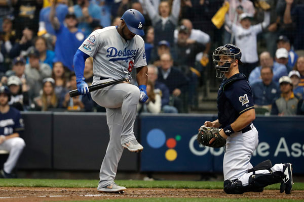 <div class='meta'><div class='origin-logo' data-origin='AP'></div><span class='caption-text' data-credit='AP Photo/Jeff Roberson'>Los Angeles Dodgers' Yasiel Puig breaks a bat after striking out during the seventh inning of Game 2 of the National League Championship Series baseball game in Milwaukee.</span></div>