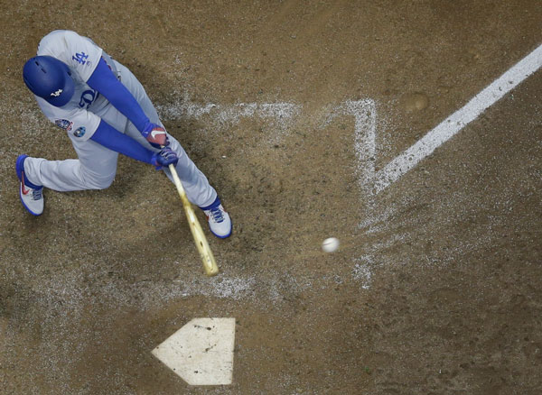 <div class='meta'><div class='origin-logo' data-origin='AP'></div><span class='caption-text' data-credit='AP Photo/Morry Gash'>Los Angeles Dodgers' Matt Kemp hits an RBI single during the eighth inning of Game 1 of the National League Championship Series baseball game in Milwaukee.</span></div>