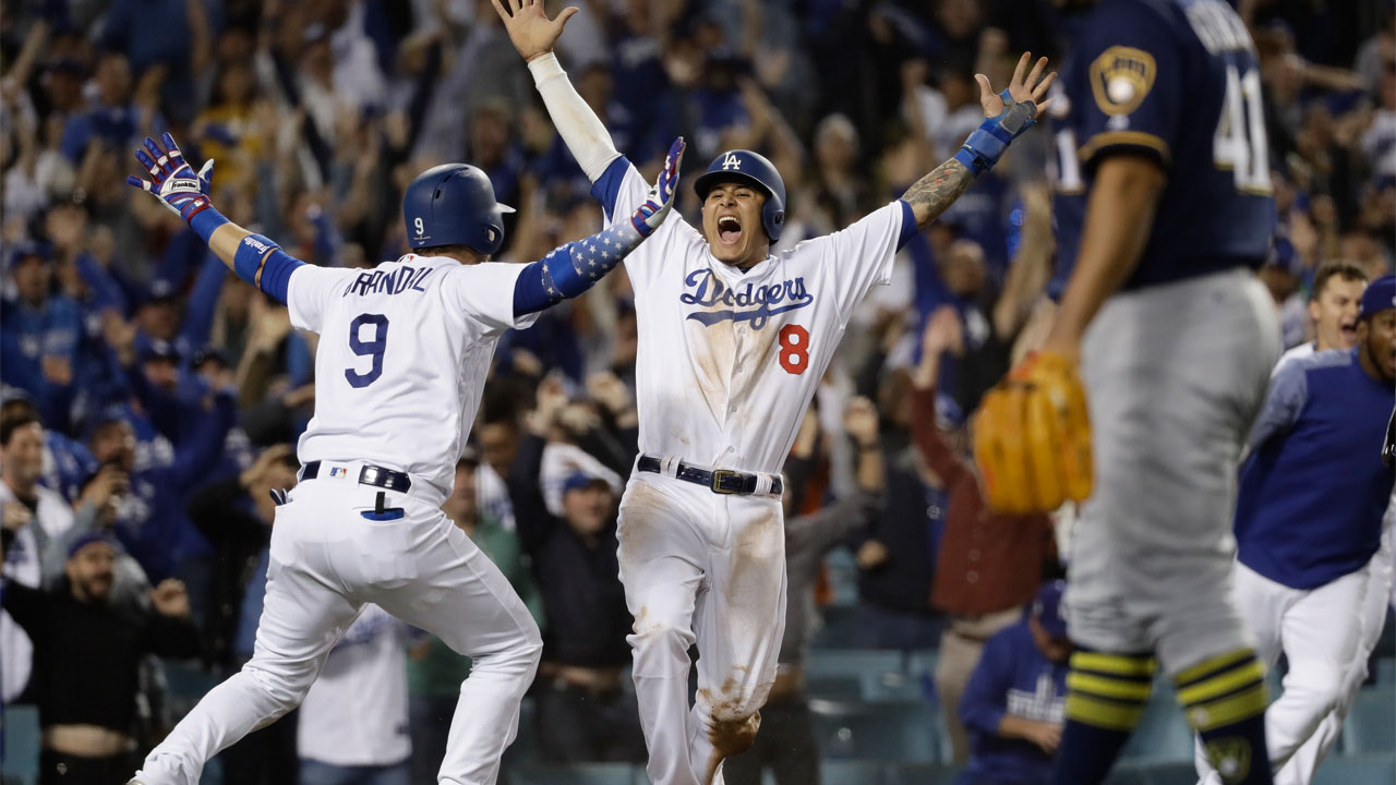 <div class='meta'><div class='origin-logo' data-origin='AP'></div><span class='caption-text' data-credit='AP Photo/Matt Slocum'>L.A. Dodgers' Manny Machado reacts after scoring on a Cody Bellinger walk-off hit during the 13th inning of Game 4 of the National League Championship Series on Oct. 16, 2018.</span></div>