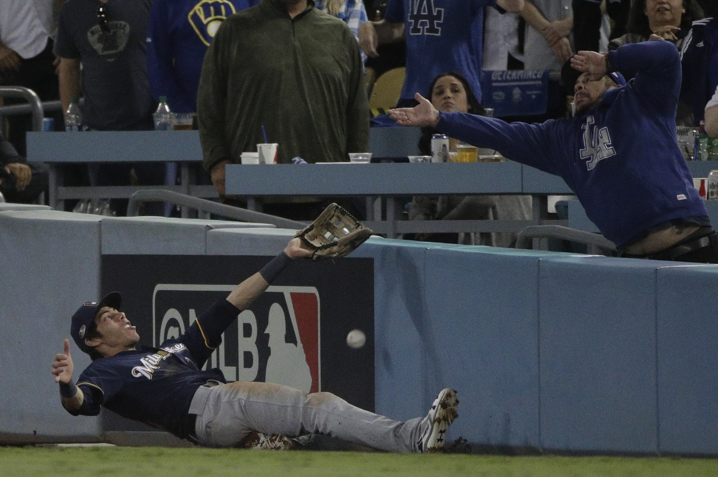 <div class='meta'><div class='origin-logo' data-origin='AP'></div><span class='caption-text' data-credit='AP Photo/Jae Hong'>Milwaukee Brewers' Christian Yelich can't catch a foul ball hit by Los Angeles Dodgers' Brian Dozier during the eighth inning of Game 4 of the NLCS.</span></div>