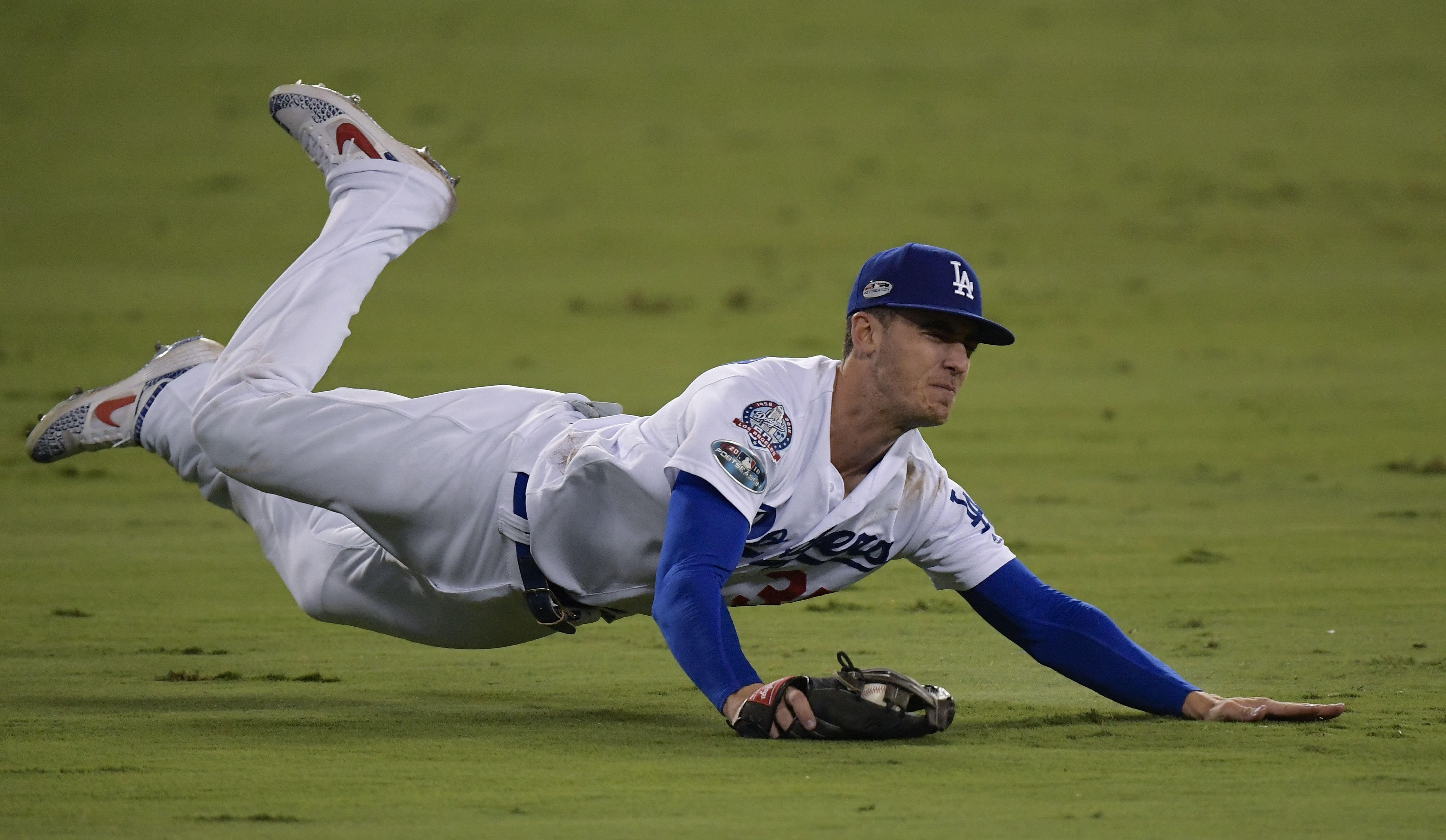 <div class='meta'><div class='origin-logo' data-origin='AP'></div><span class='caption-text' data-credit='AP Photo/Mark J. Terrill'>Dodgers' Cody Bellinger makes a diving catch on a ball hit by Milwaukee Brewers' Lorenzo Cain during the 10th inning of Game 4 of the NLCS.</span></div>