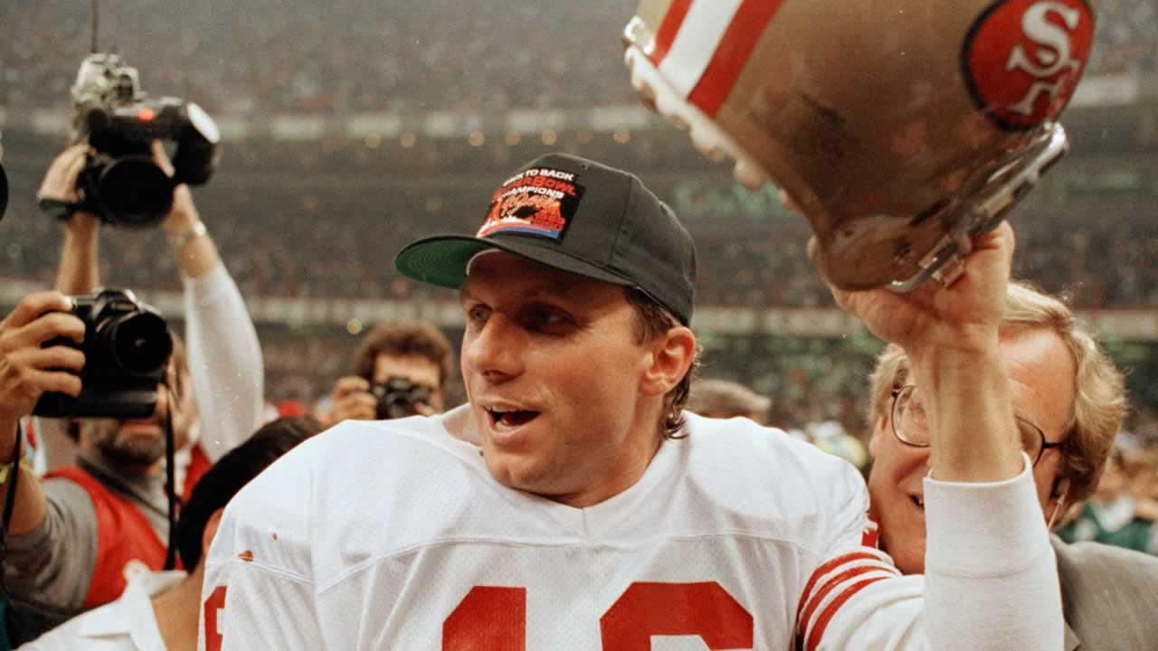 San Francisco 49ers quarterback Joe Montana raises his helmet following the team's 55-10 victory over the Denver Broncos in the Super Bowl in New Orleans, La., Jan. 28, 1990.