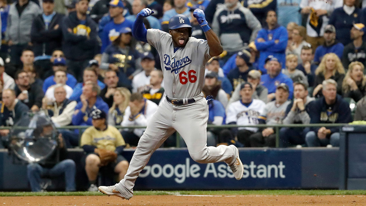 <div class='meta'><div class='origin-logo' data-origin='AP'></div><span class='caption-text' data-credit='AP Photo/Jeff Roberson'>Los Angeles Dodgers' Yasiel Puig celebrates as he runs bases after hitting a three-run home run during the sixth inning of Game 7 of the National League Championship Series.</span></div>