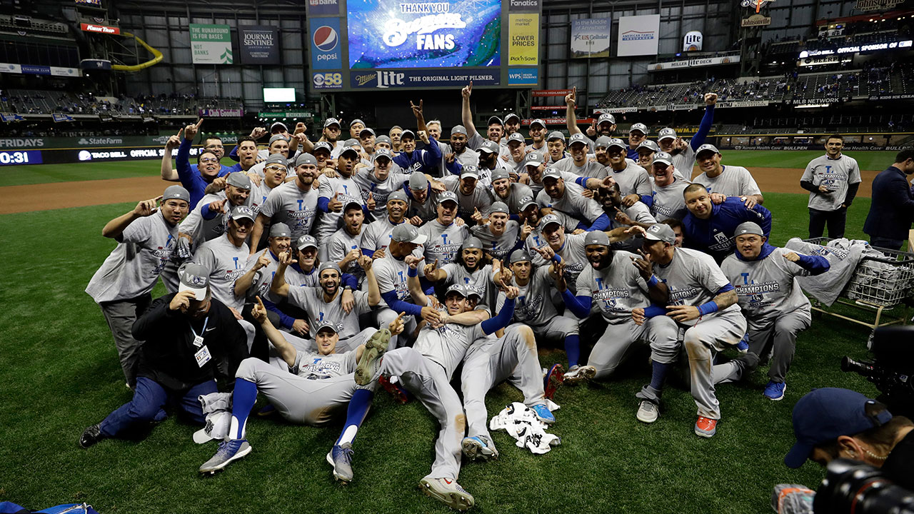 <div class='meta'><div class='origin-logo' data-origin='AP'></div><span class='caption-text' data-credit='AP Photo/Matt Slocum'>The Los Angeles Dodgers celebrate after winning Game 7 of the National League Championship Series against the Milwaukee Brewers.</span></div>