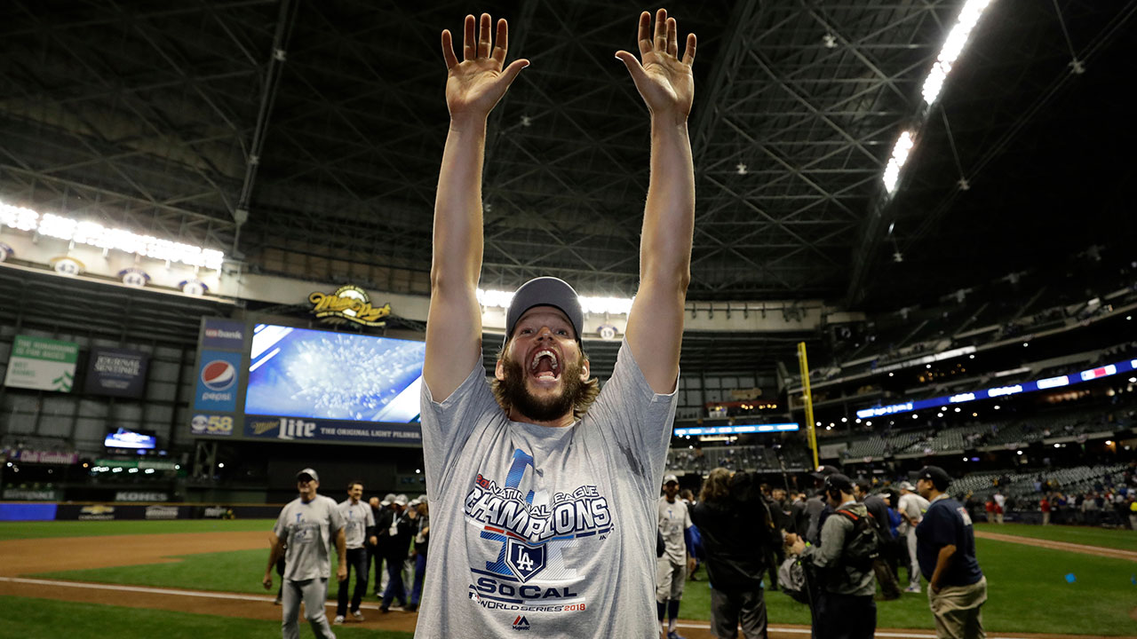 <div class='meta'><div class='origin-logo' data-origin='none'></div><span class='caption-text' data-credit='AP Photo/Matt Slocum'>Los Angeles Dodgers' Clayton Kershaw celebrates after winning Game 7 of the National League Championship Series baseball game against the Milwaukee Brewers</span></div>