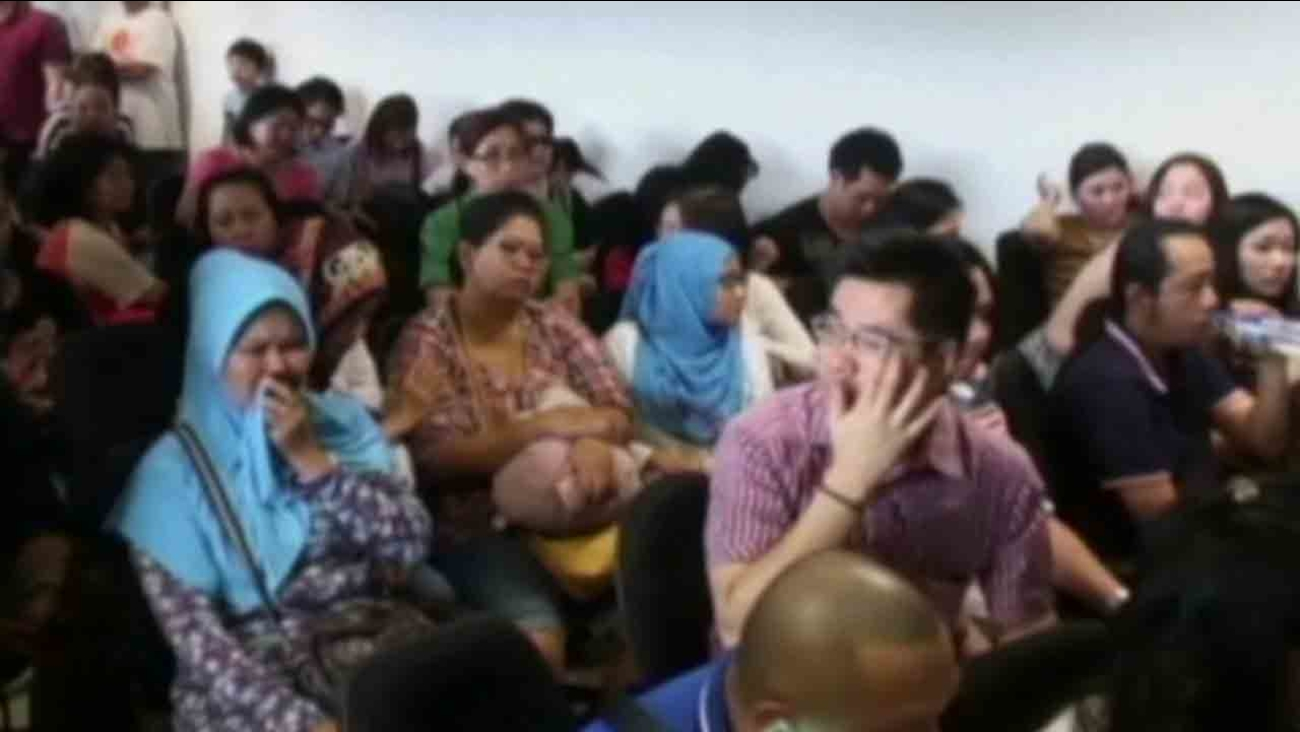 Dozens of relatives of people aboard the missing AirAsia jet gathered in a room at Surabaya airport Sunday, Dec. 29, 2014 to await word about their loved ones.