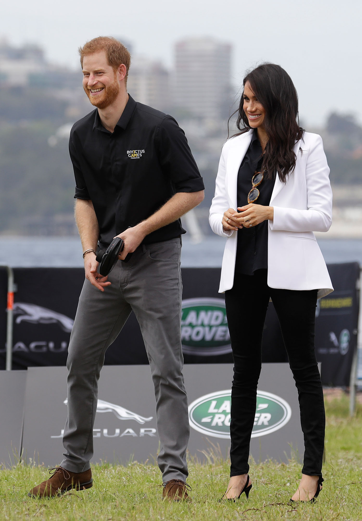 "<div class=""meta image-caption""><div class=""origin-logo origin-image none""><span>none</span></div><span class=""caption-text"">Prince Harry operates a remote control car with Meghan, Duchess of Sussex at the Invictus Games driving challenge on Cockatoo Island in Sydney, Australia, Saturday, Oct. 20. (Kirsty Wigglesworth/AP Photo)</span></div>"