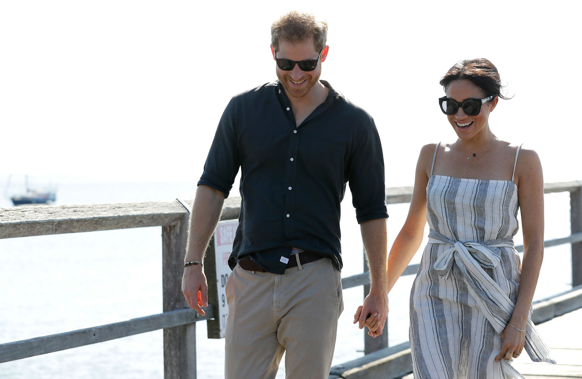"<div class=""meta image-caption""><div class=""origin-logo origin-image none""><span>none</span></div><span class=""caption-text"">Britain's Prince Harry, left, and Meghan, Duchess of Sussex walk along Kingfisher Bay Jetty during a visit to Fraser Island, Australia, Monday, Oct. 22, 2018 (Kirsty Wigglesworth, Pool/AP Photo)</span></div>"
