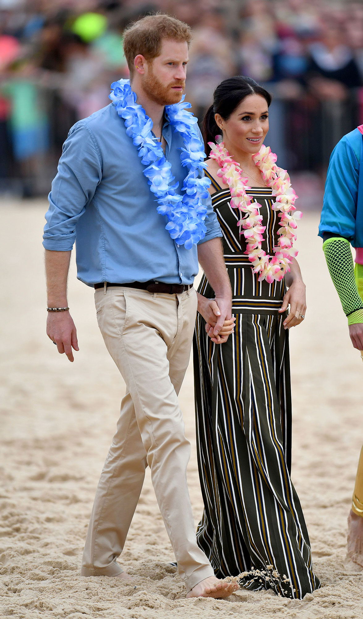 "<div class=""meta image-caption""><div class=""origin-logo origin-image none""><span>none</span></div><span class=""caption-text"">Prince Harry and Meghan, Duchess of Sussex meet a local surfing community group, known as OneWave at Bondi Beach Sydney, Australia, Friday, Oct. 19. (Dominic Lipinski/Pool via AP)</span></div>"