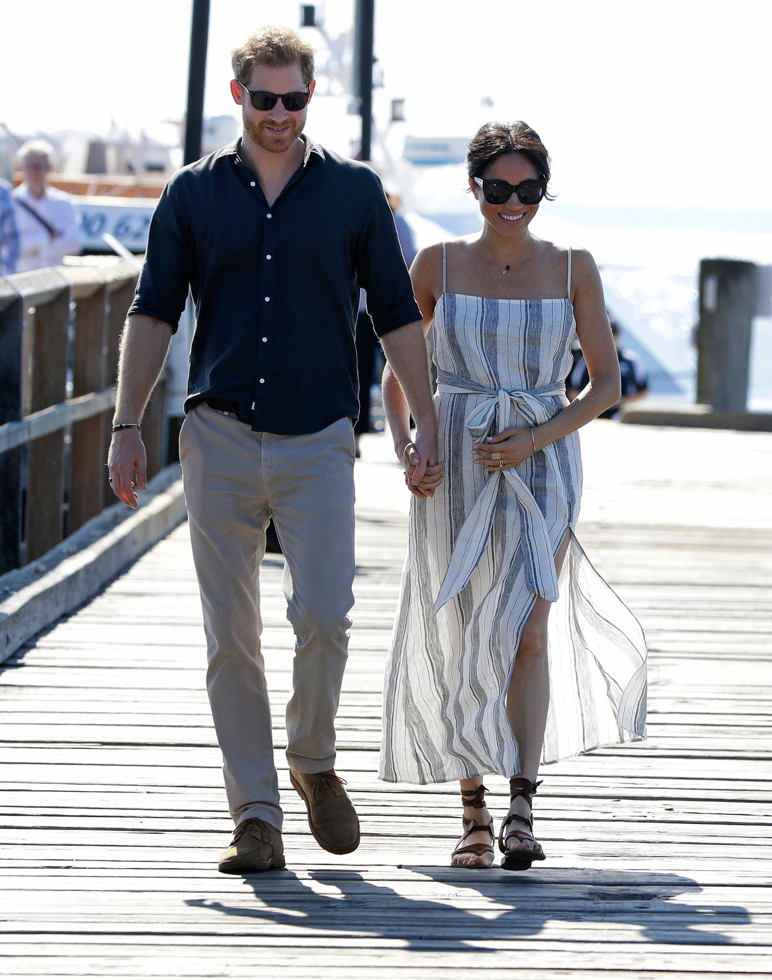 "<div class=""meta image-caption""><div class=""origin-logo origin-image none""><span>none</span></div><span class=""caption-text"">Britain's Prince Harry and Meghan, Duchess of Sussex walk along Kingfisher Bay Jetty during a visit to Fraser Island, Australia, Monday, Oct. 22, 2018. (Kirsty Wigglesworth, Pool/AP Photo)</span></div>"