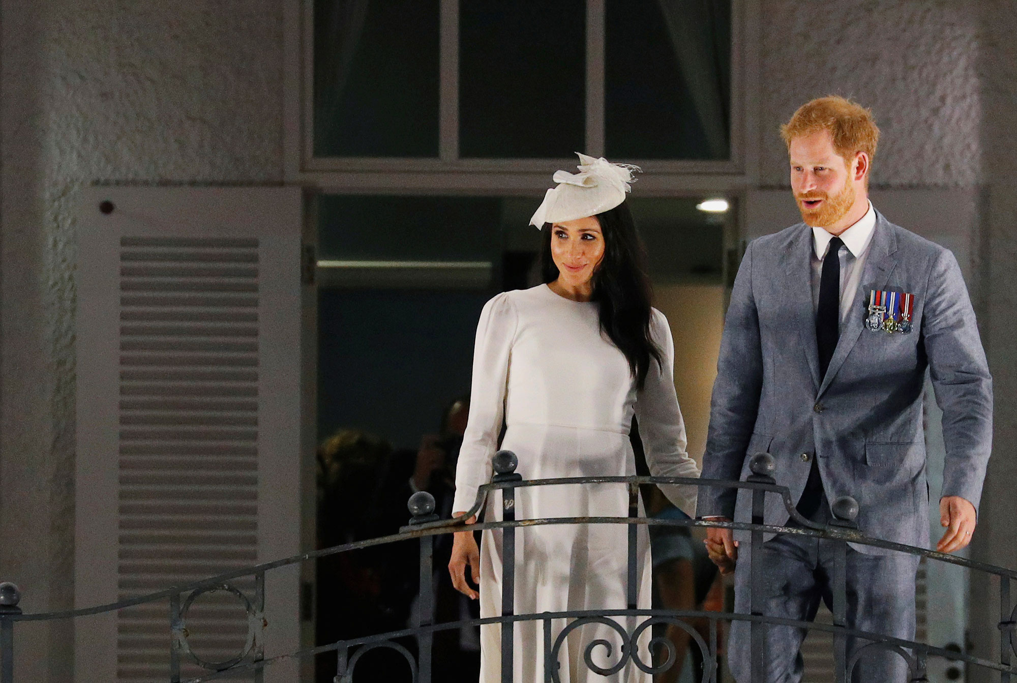 <div class='meta'><div class='origin-logo' data-origin='none'></div><span class='caption-text' data-credit='Phil Noble/Pool Photo via AP'>Britain's Prince Harry and Meghan, Duchess of Sussex wave from the balcony of the Grand Pacific Hotel in Suva, Fiji, Tuesday, Oct. 23, 2018.</span></div>